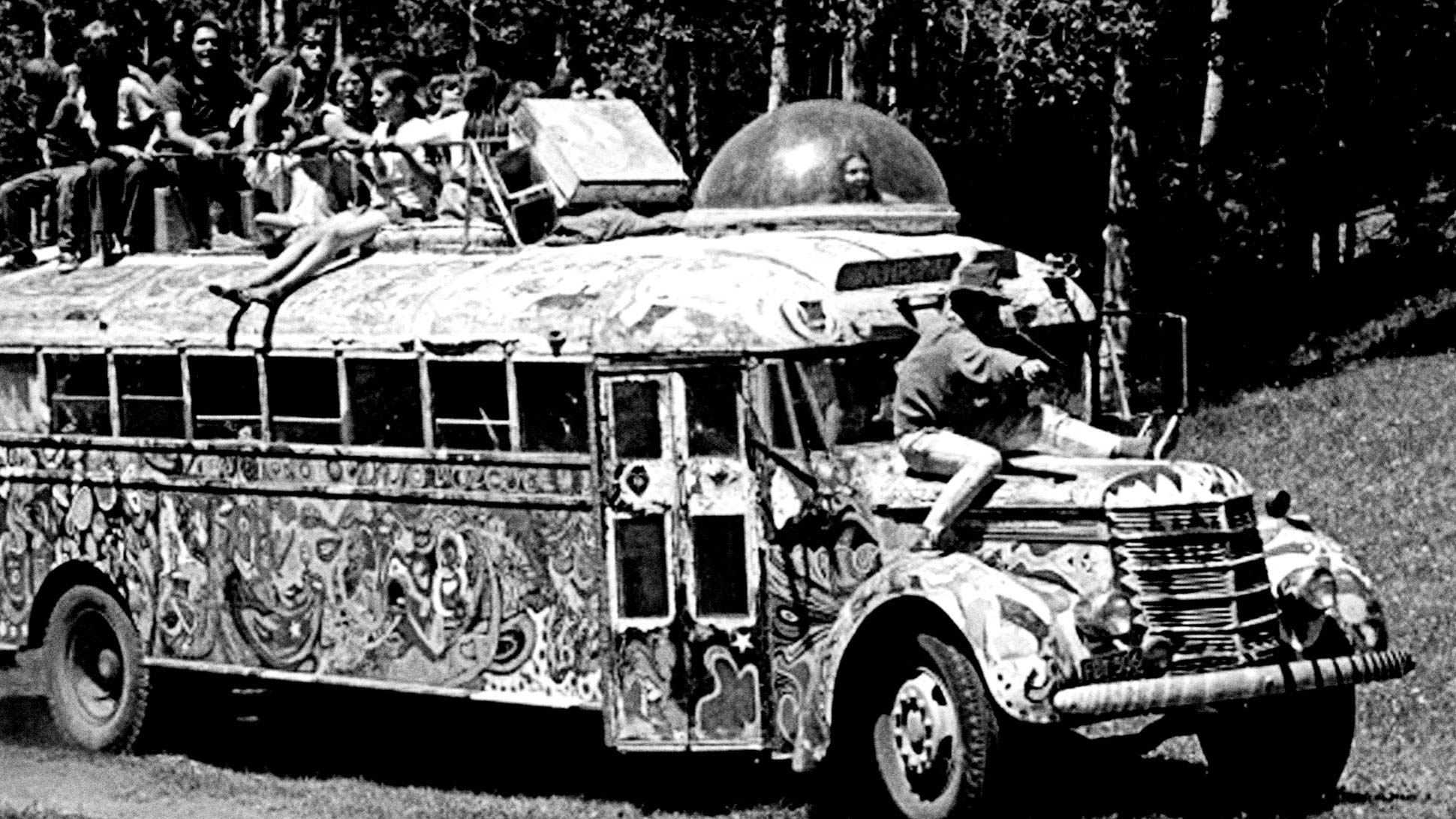 Ken Kesey and the Merry Pranksters roll into town on their psychedelic ride, 'Further', during the Great Bus Race in Aspen Meadows, Santa Fe, New Mexico. Summer Solstice, June 21, 1969. Photo by Lisa Law