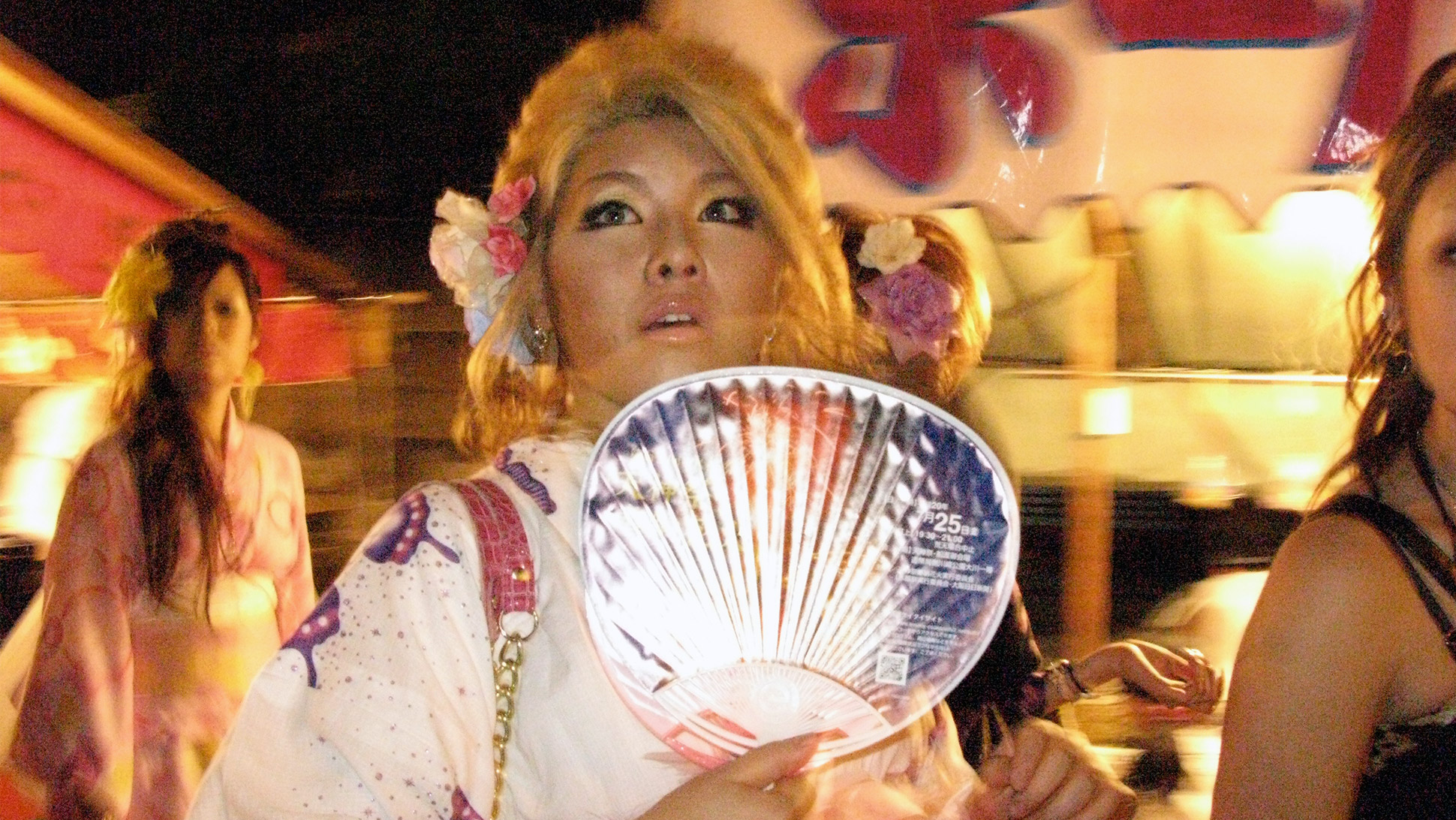 Tenjin Matsuri in Osaka, a summertime Carnival of sorts replete with kimonos, portable shrines, fireworks, and fan-waving nubiles with $1,500 handbags.