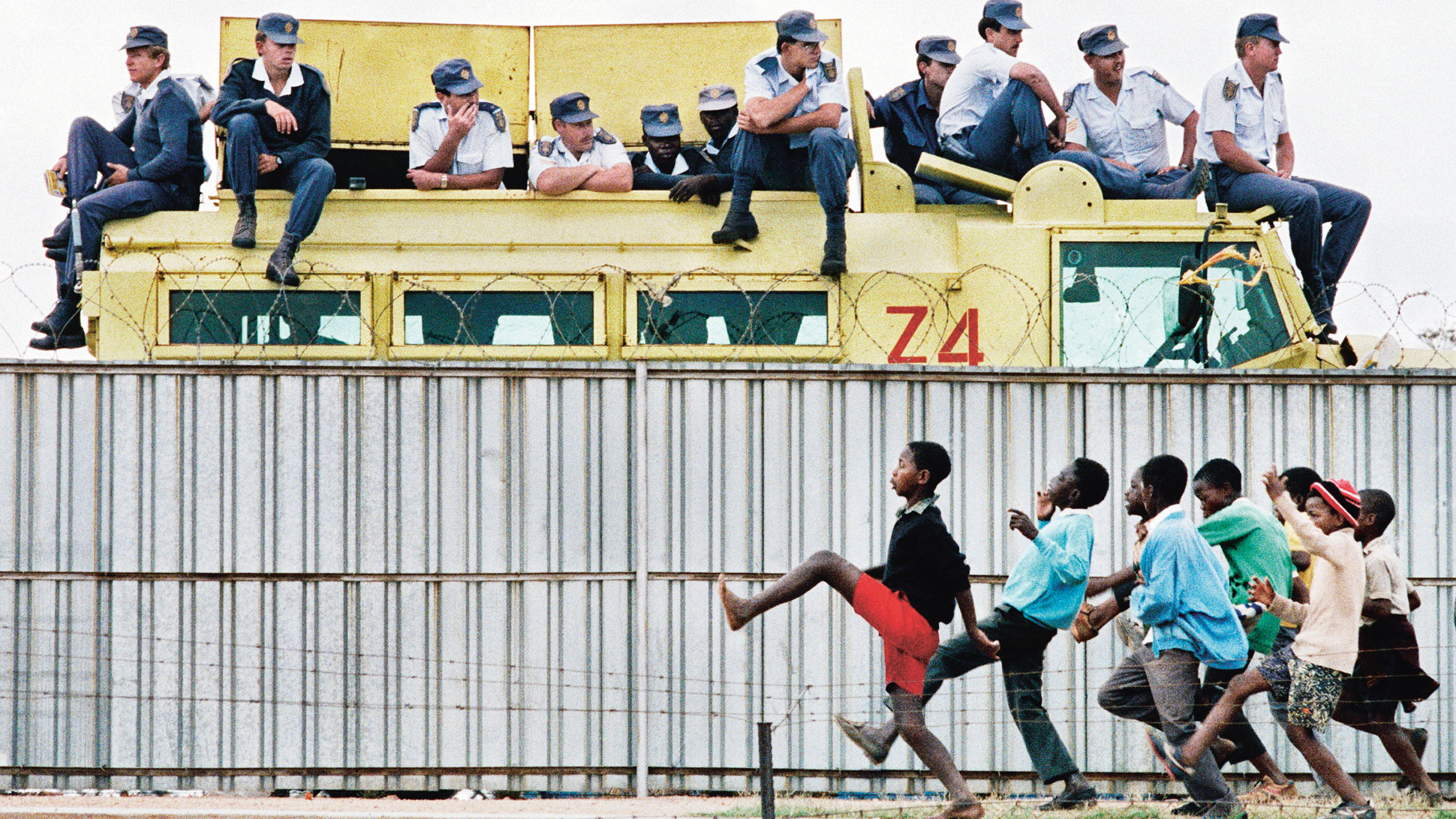 THEN: Youths taunt police during an ANC political rally at the Sam Ntuli Sports Stadium, Thokoza, South Africa, 1991.