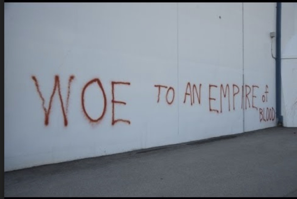 Plowshares activists' message painted on the wall of Y12.