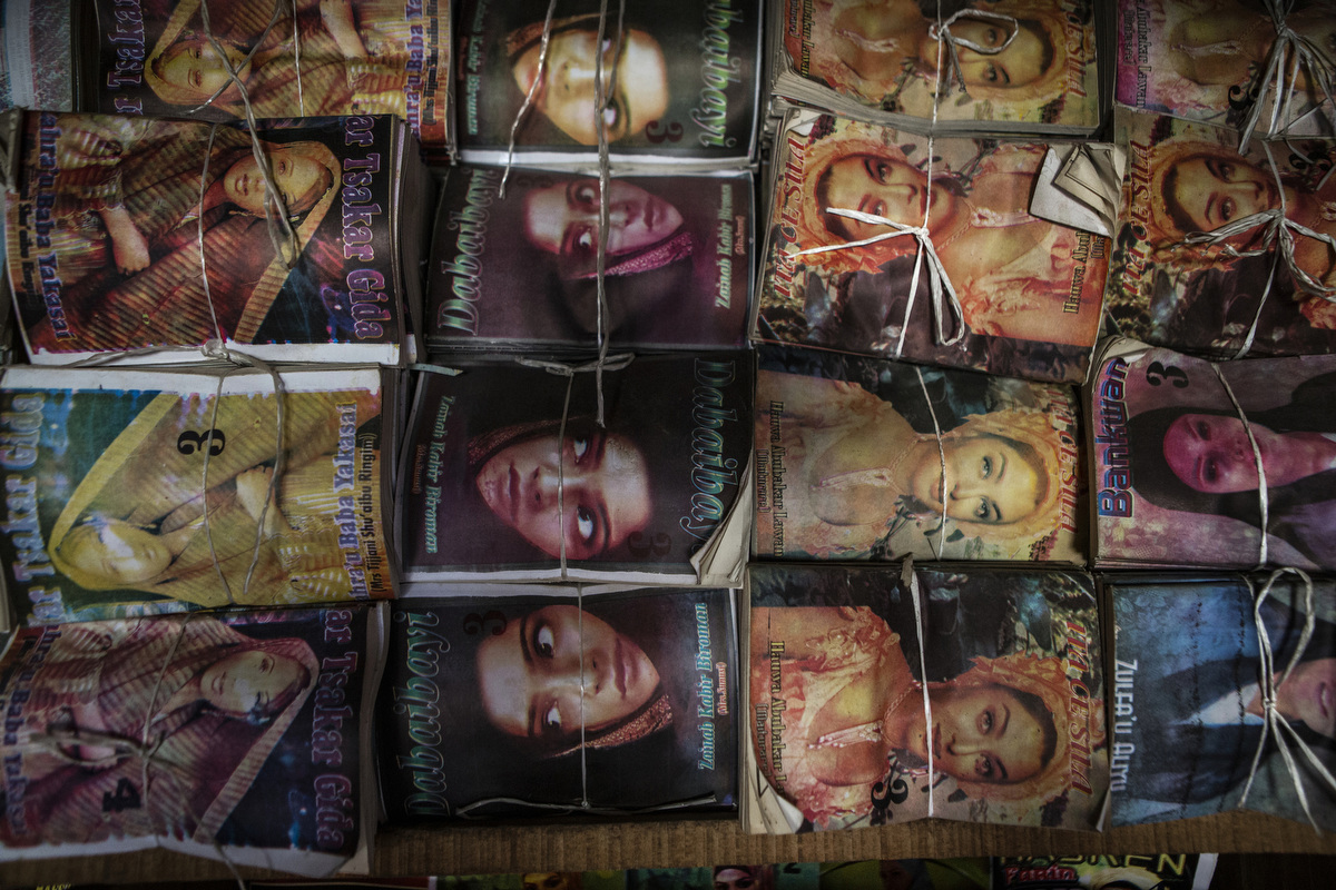 Subversive romance novels are tied up and packaged at the local market in Kano.