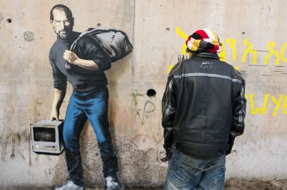 Steve Jobs Banksy street art Calais jungle refugee camp