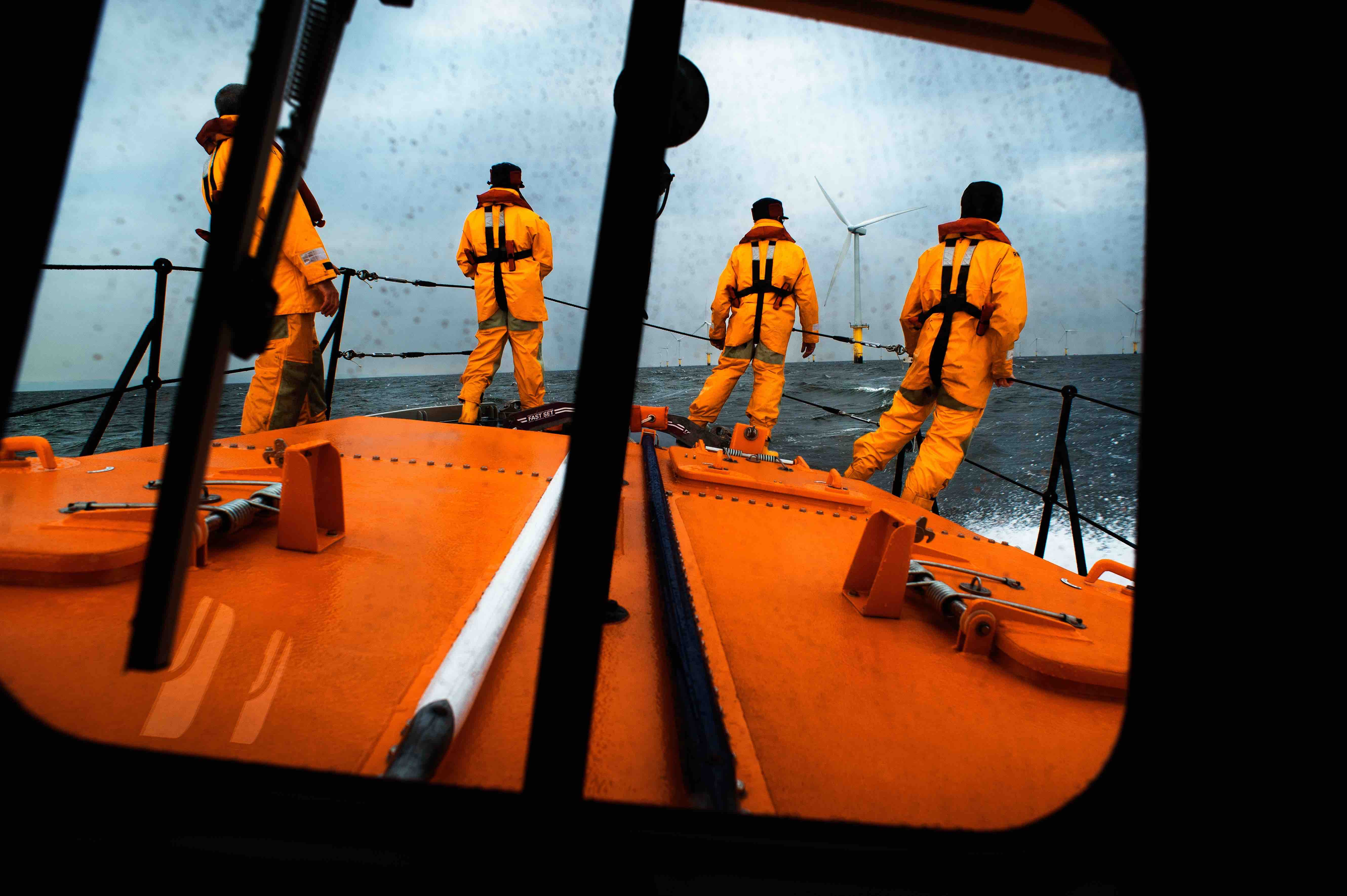 The view from the wheelhouse of the Hoylake Mersey class lifeboat Lady of Hilbre 12-005, as the crew search for a casualty in the water near the North Hoyle wind farm. Taken from The Lifeboat: Courage on our Coasts. Page 36.