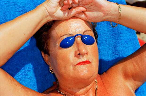 martin-parr-common-sense-woman-sunbathing-spain-1997