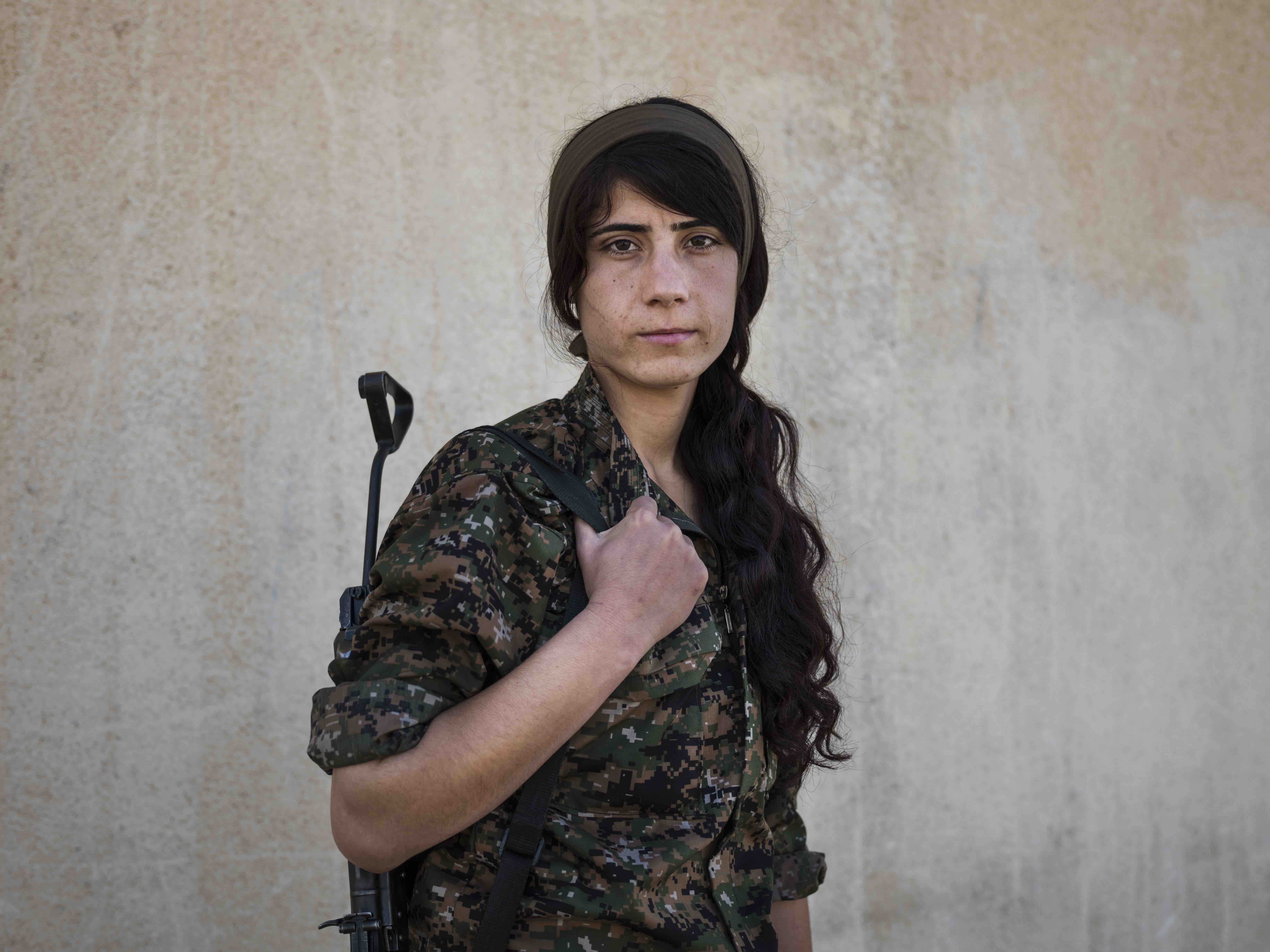Rojava Suzdar, 21, photographed in Serikani, Syria by Newsha Tavakolian