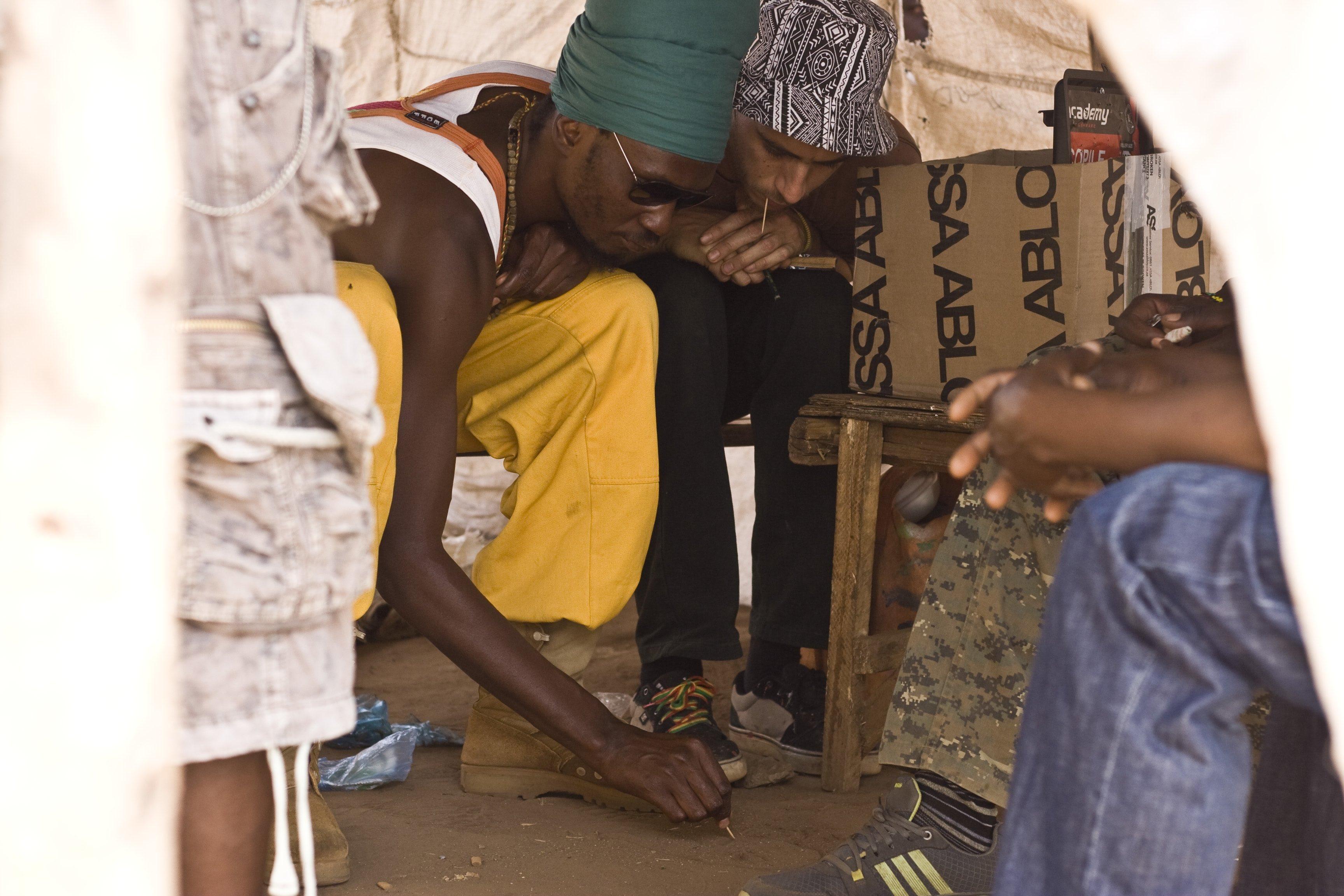 mook and raz planning in the sand_be happy barber shop_lilongwe tsoka market