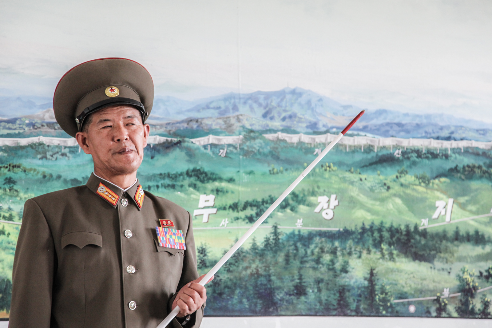 A DPRK officer illustrating a map of the DMZ in Kaesong.