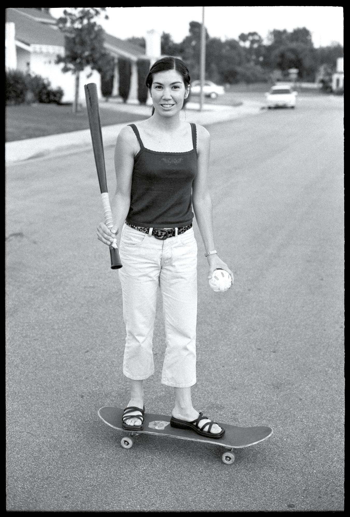Deanna-on-skateboard-w-batEd_cmyk