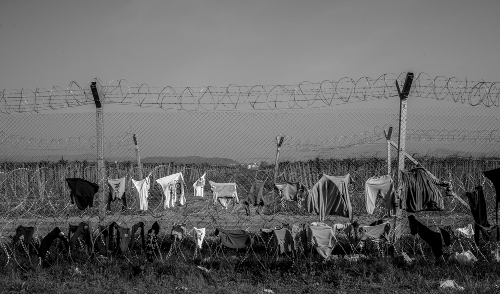The border fence between Greece and Macedonia from the Greek side in the small village of Idomeni. Migrants who have gathered here hoping to be able to pass through and on to Germany are using the fence to hang out washing.