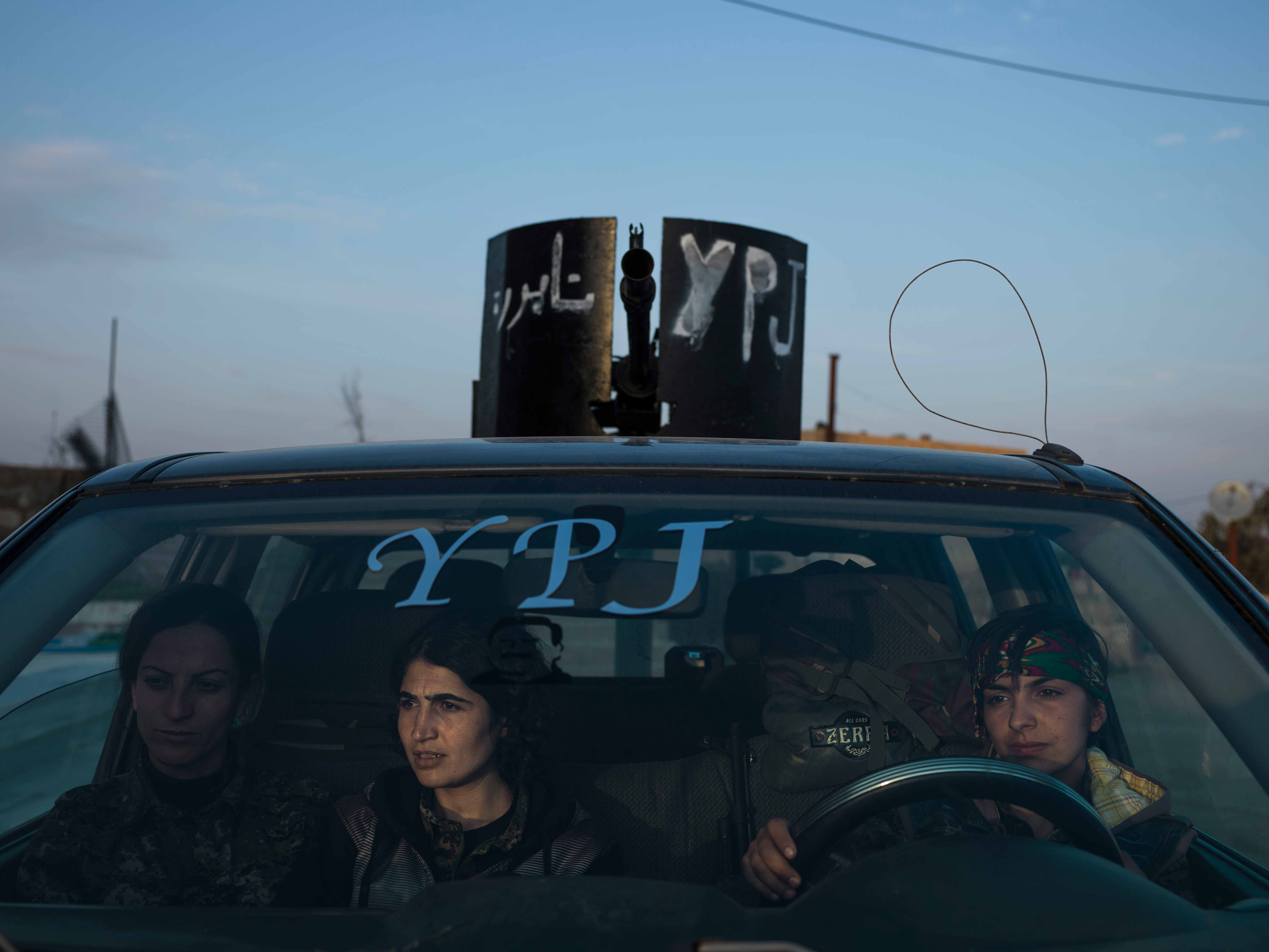 YPJ members sitting in an armed vehicle in Serikani. © Newsha Tavakolian / Magnum Photos