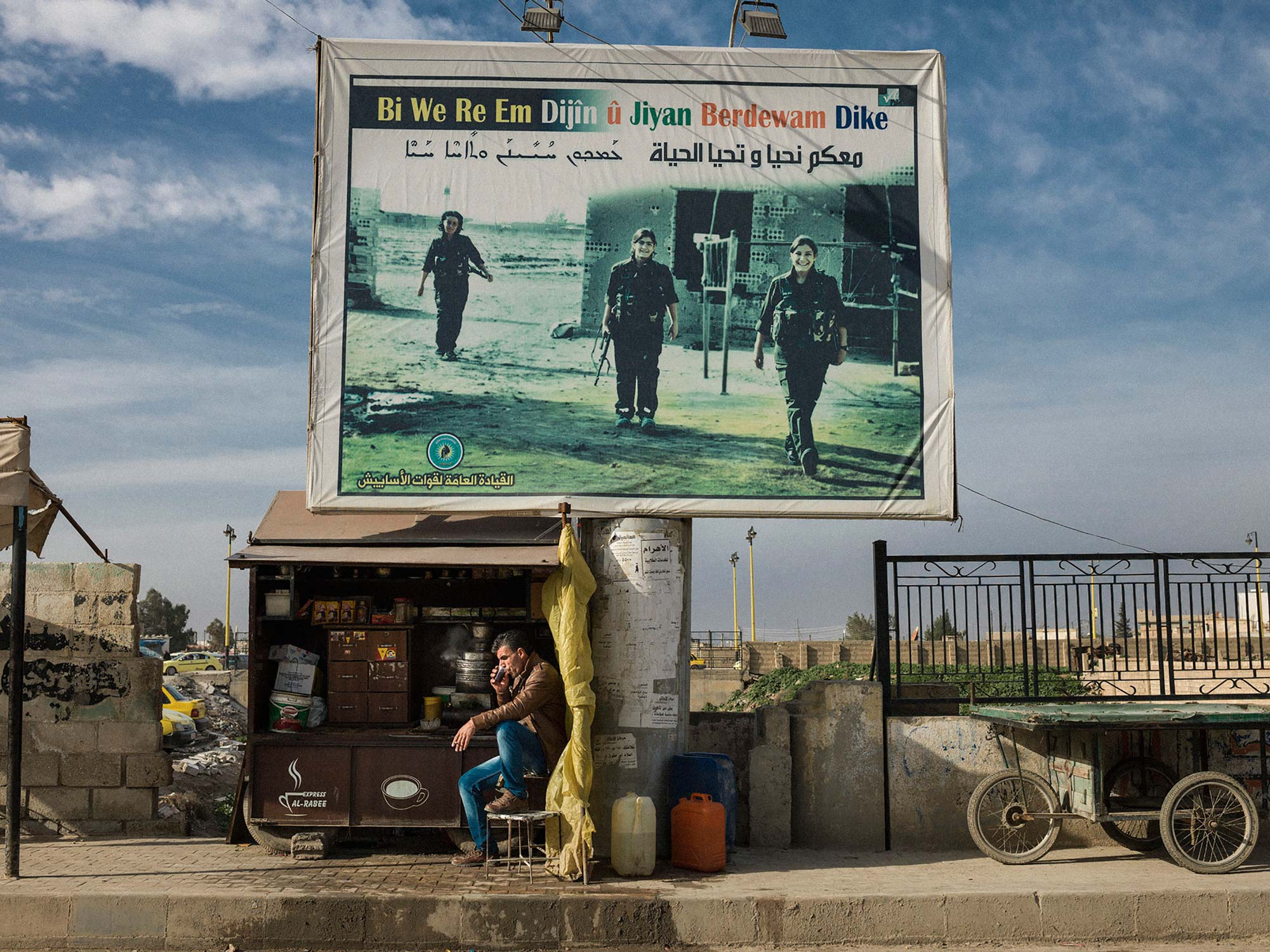 "Billboards in Qamishlou. Rojava, of martyrs who died fighting ISIS: ""with you we live on and life continues"". © Newsha Tavakolian / Magnum Photos"