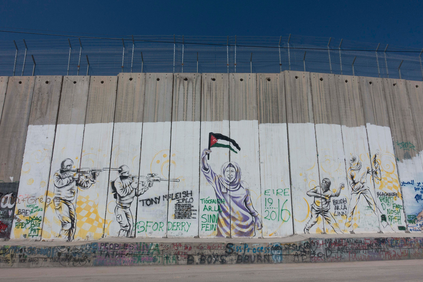 Anti-Israeli icons on the Partition Wall in Bethlehem.