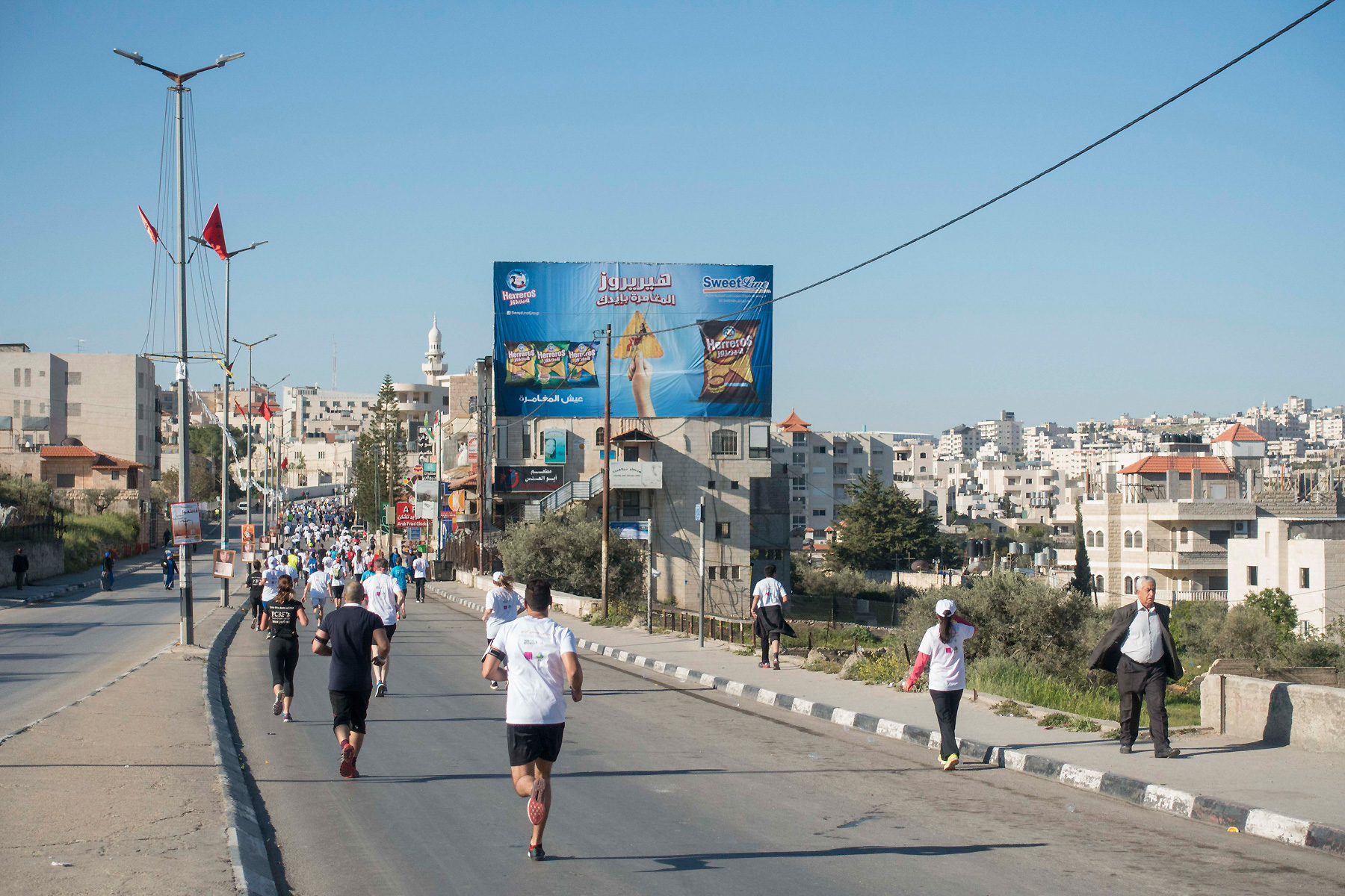 Running through along Hebron Road during the 2016 Palestine Marathon