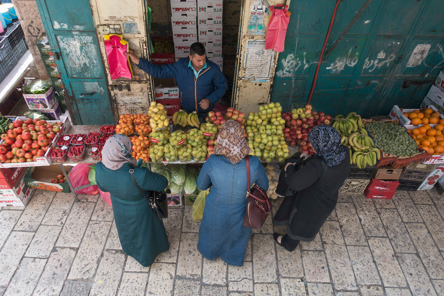 Women shop for fruit next to Jaffa Gate in the Old City Jerusalem