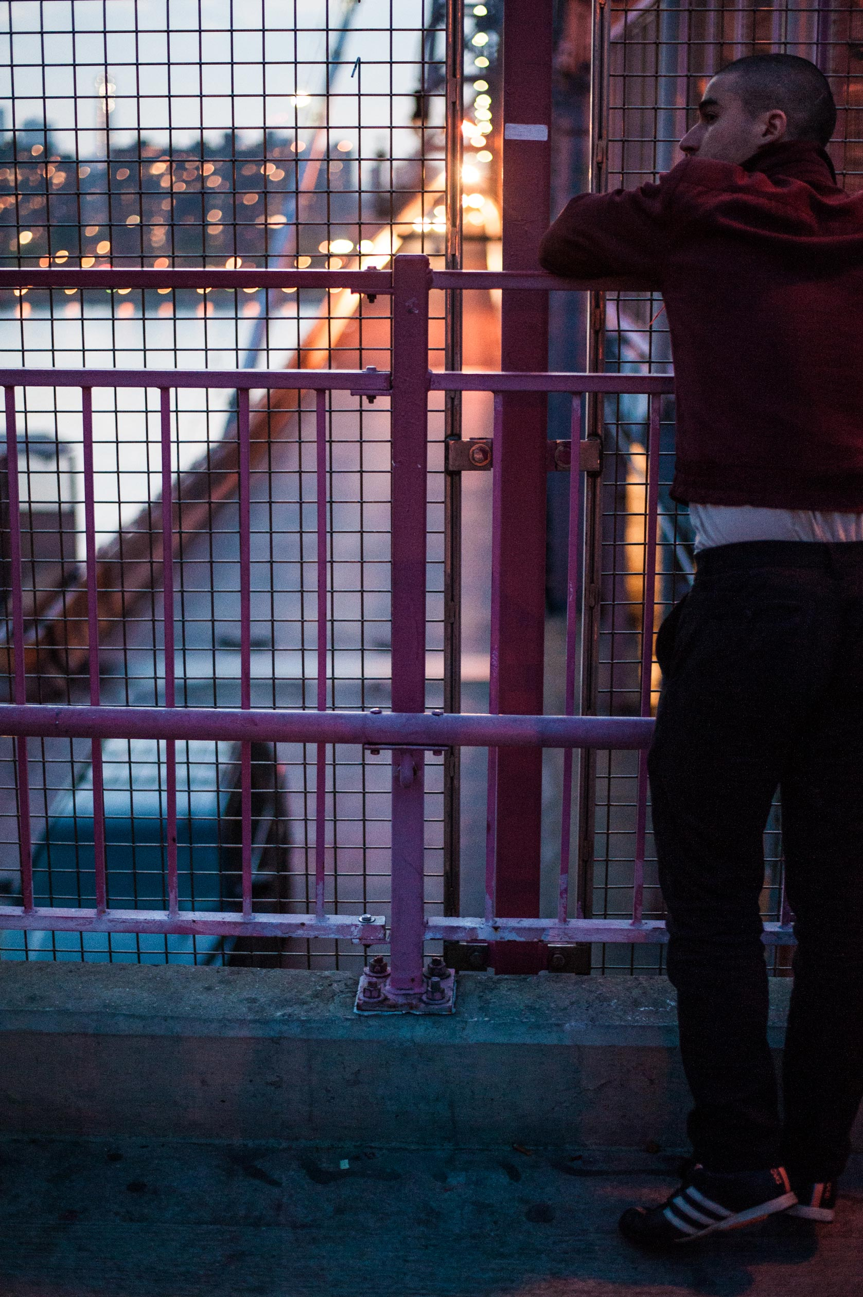 Nathan leans against the Williamsburg Bridge during an interview with Rolling Stone.