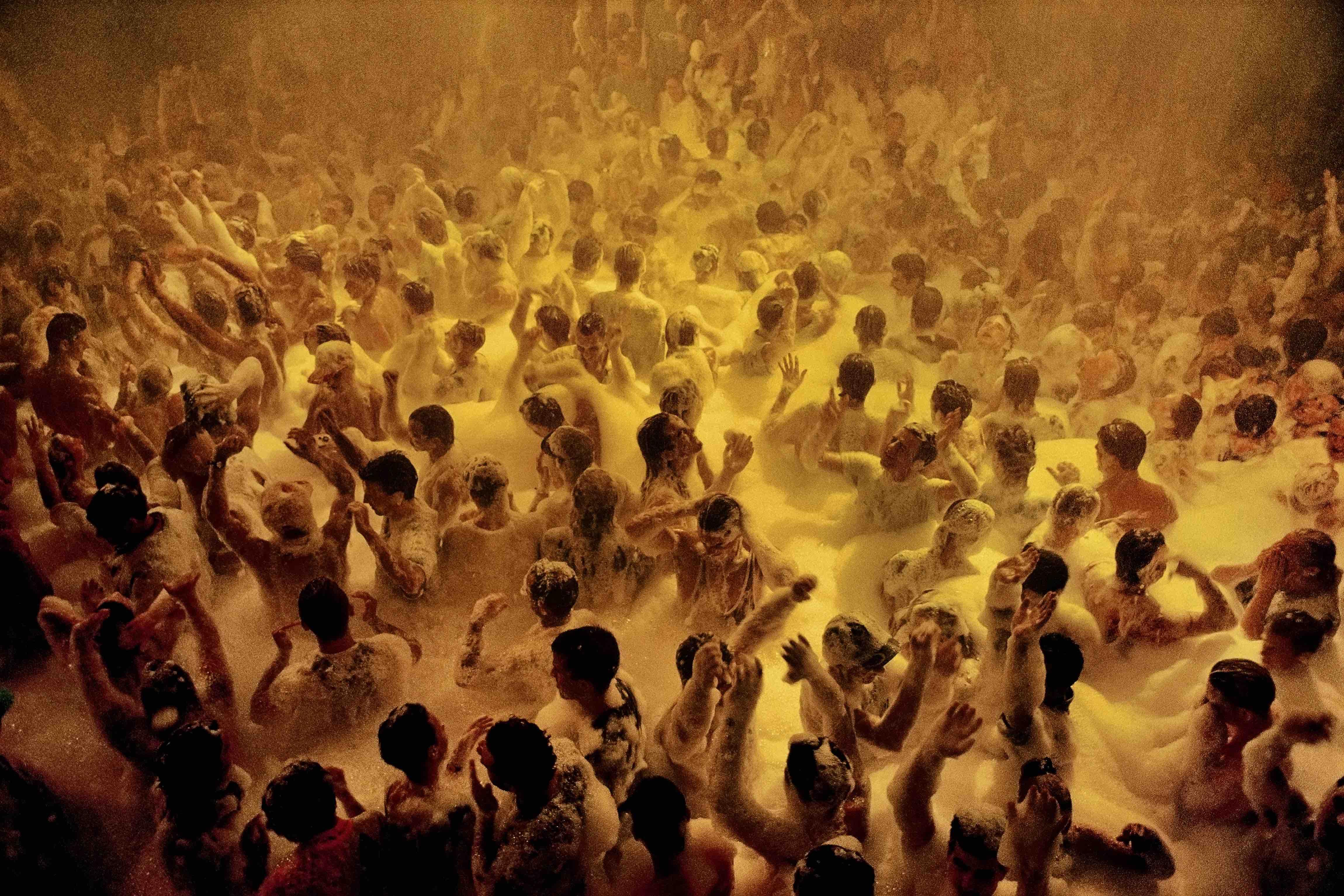 Spain. Ibiza. 1991. Soap suds party. © David Alan Harvey / Magnum Photos