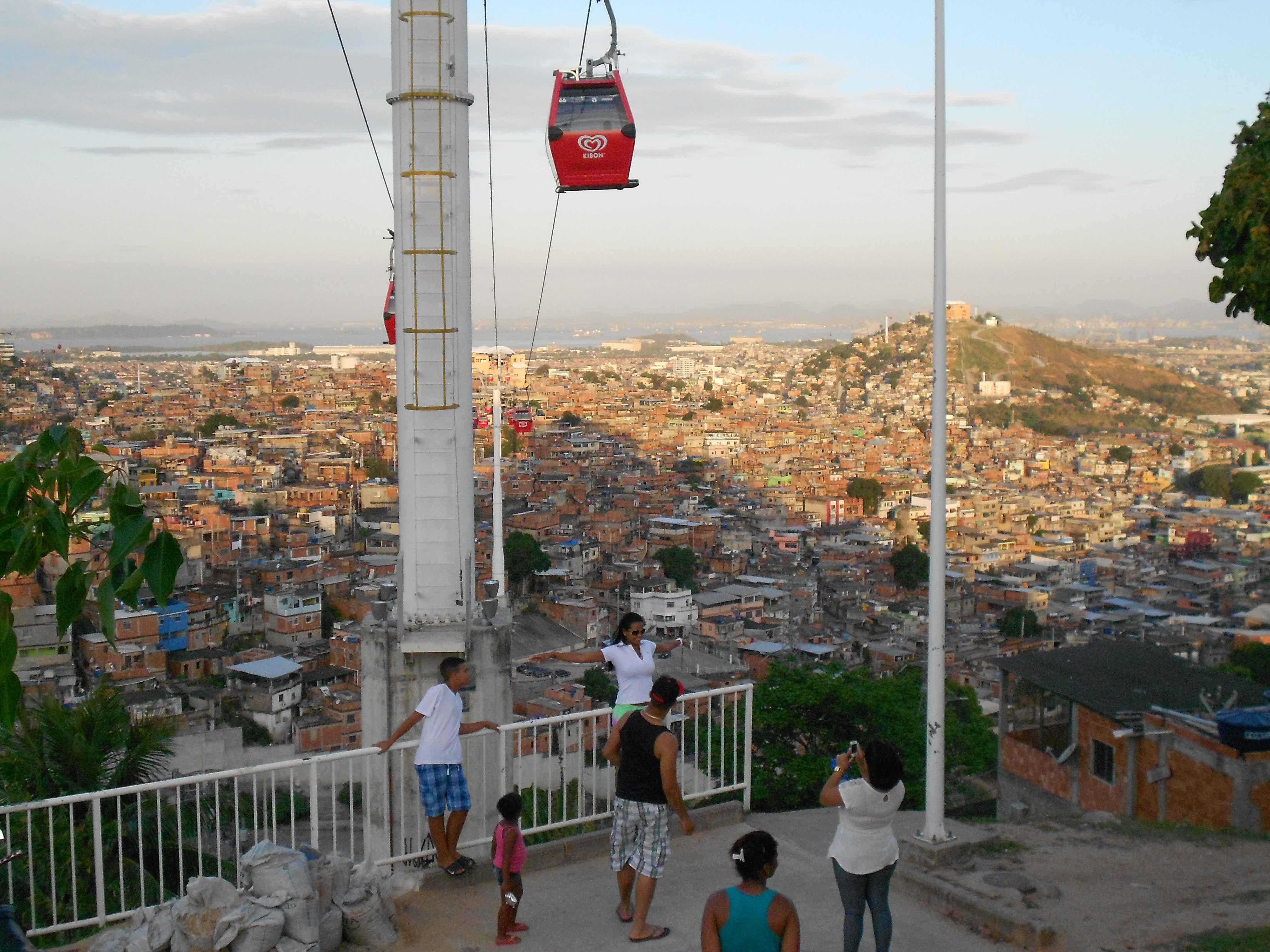 Tourists Posing in front of the Cable Car of Complexo Alemao, Rio De Janeiro