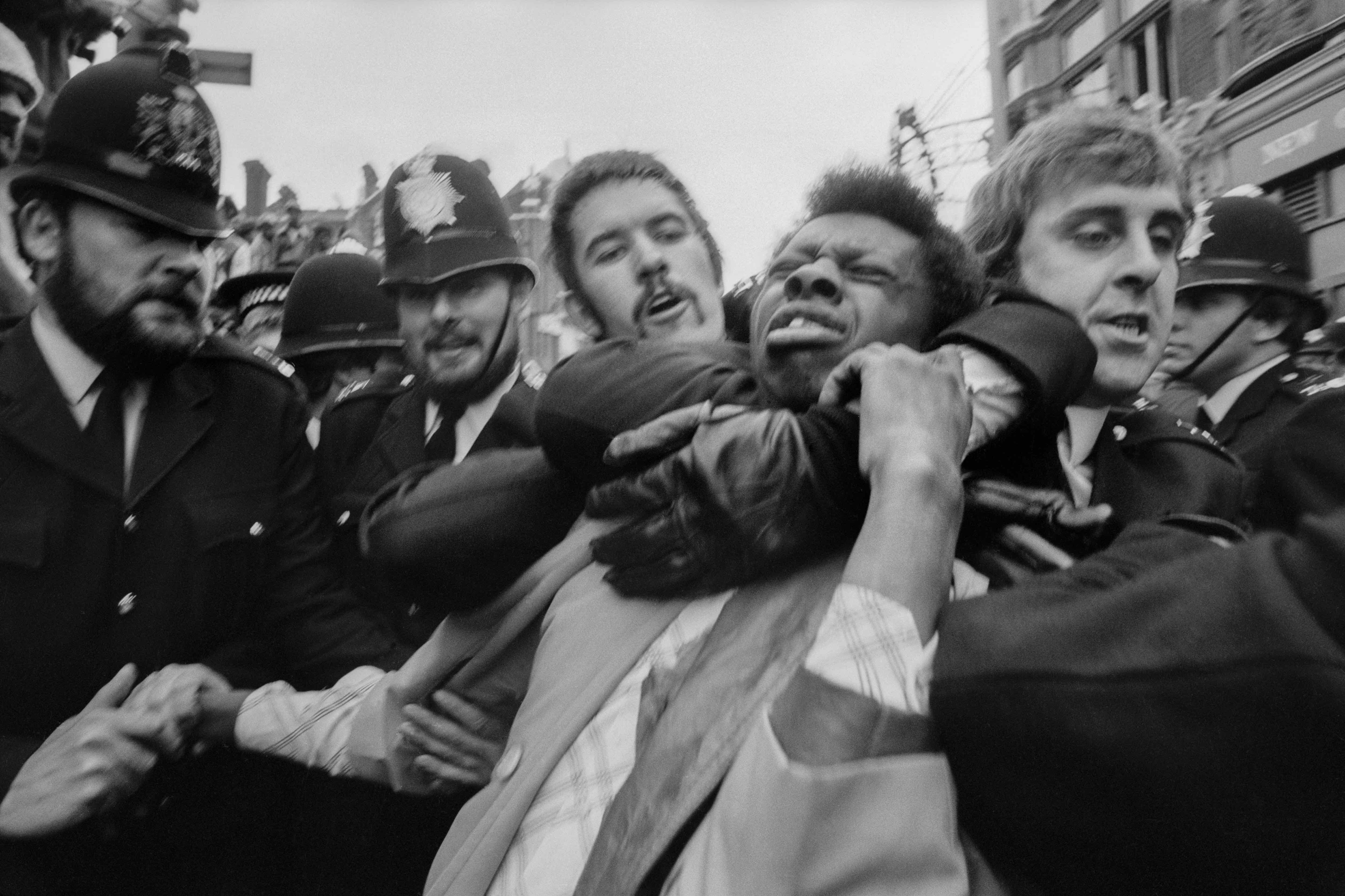 GB. ENGLAND. London. Race Riots in Lewisham. Police making an arrest. 1977.