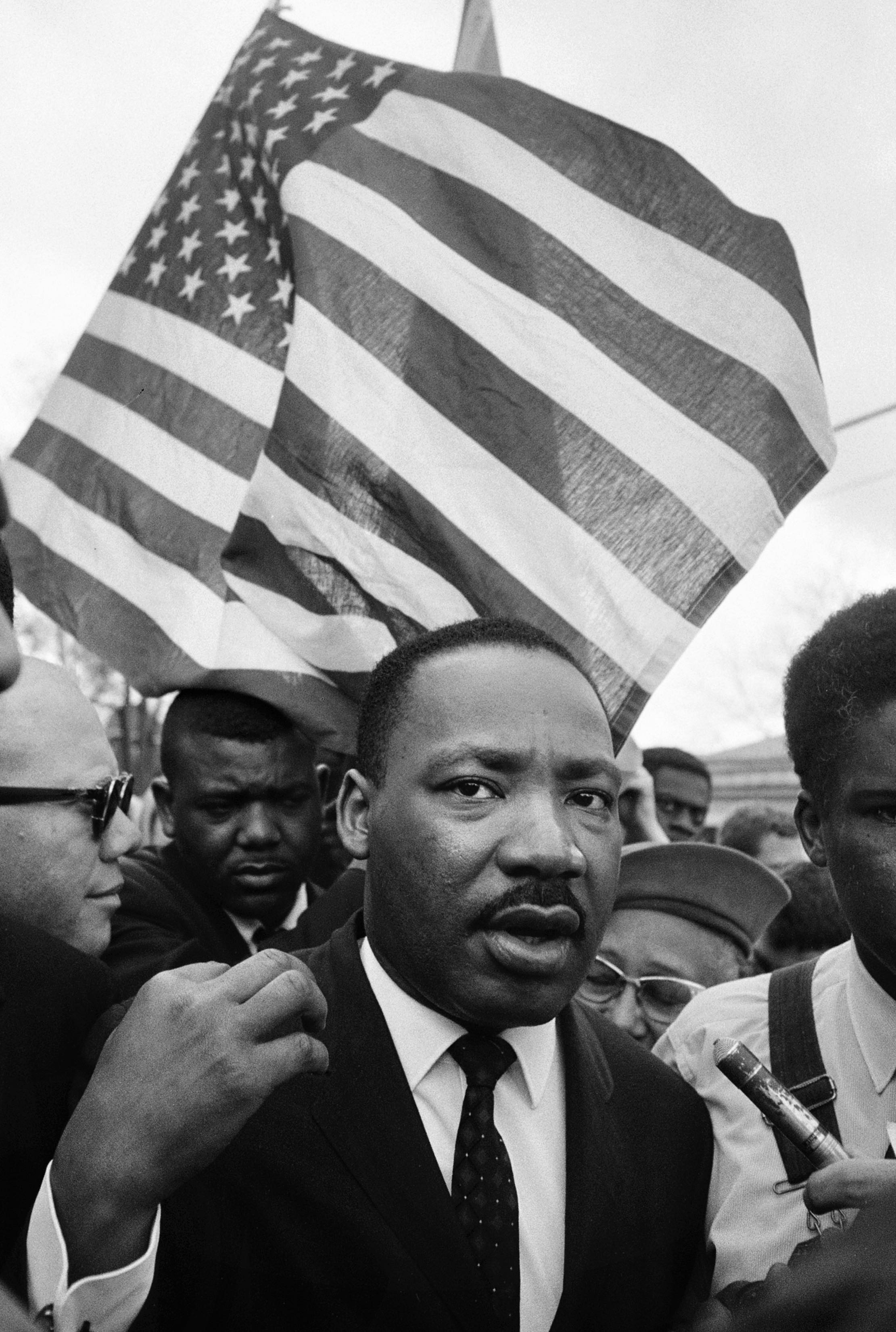 Martin Luther King with Flag, Selma March 1965 © Steve Schapiro