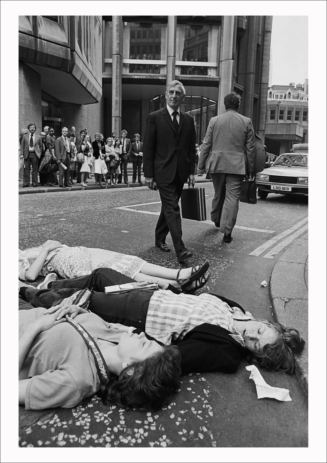 Greenham Common protesters stage a Die-in outside the Stock Exchange during the morning rush hour as U.S President Reagan arrives in Britain, City of London, 1982