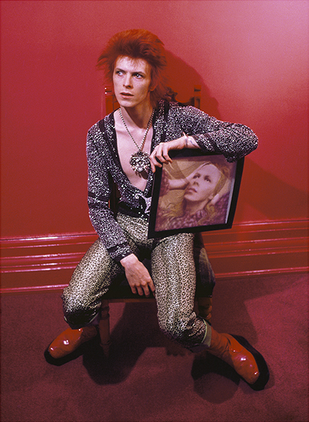 David Bowie with Hunky Dory album cover, Haddon Hall, UK, 1973, © Mick Rock / courtesy The Print Room