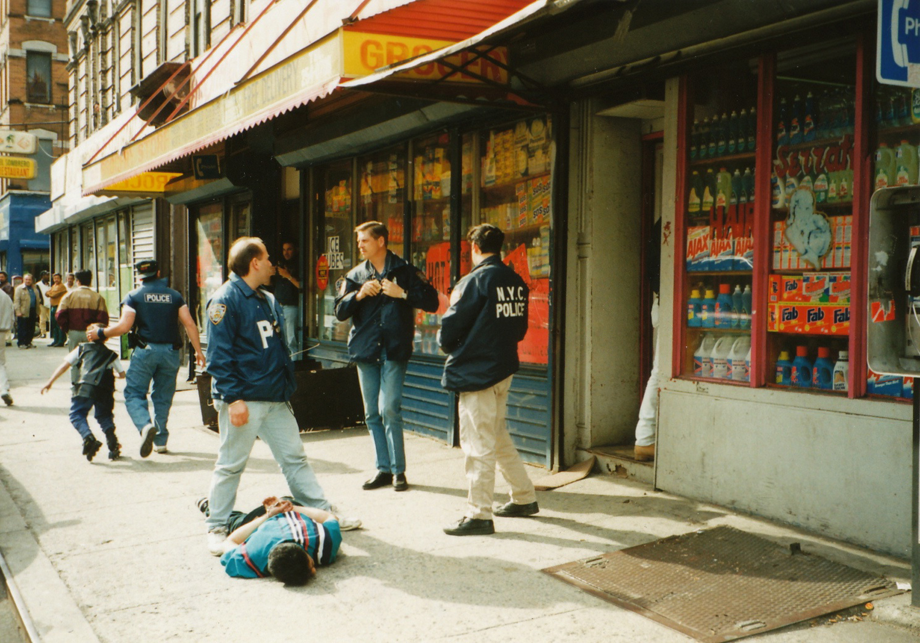 Drug arrest at 179 Essex street in 1995. Typical example of a neighbourhood grocery store whose main source of income was selling hard drugs. The Lower East Side was one of the most economically profitable and open public drug markets in America and probably the world. Drugs were sold openly all over the minority section of the community.