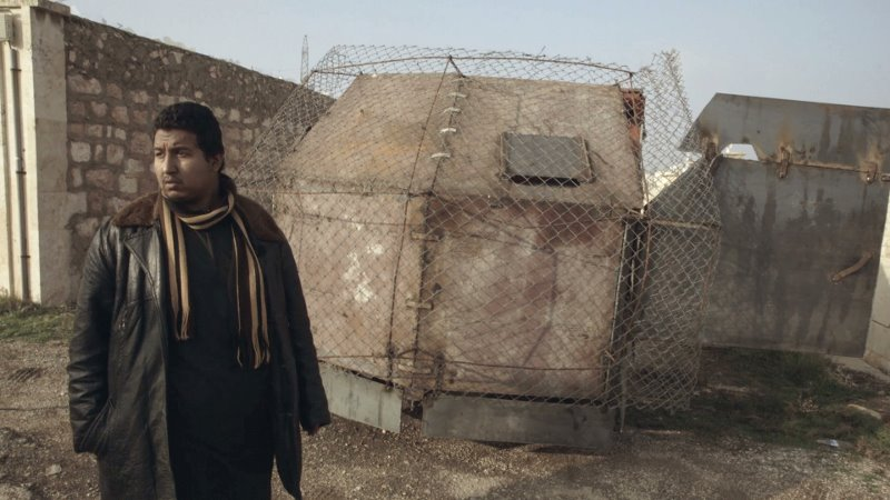 Abu Qaswara in front of an improvised armored suicide truck.
