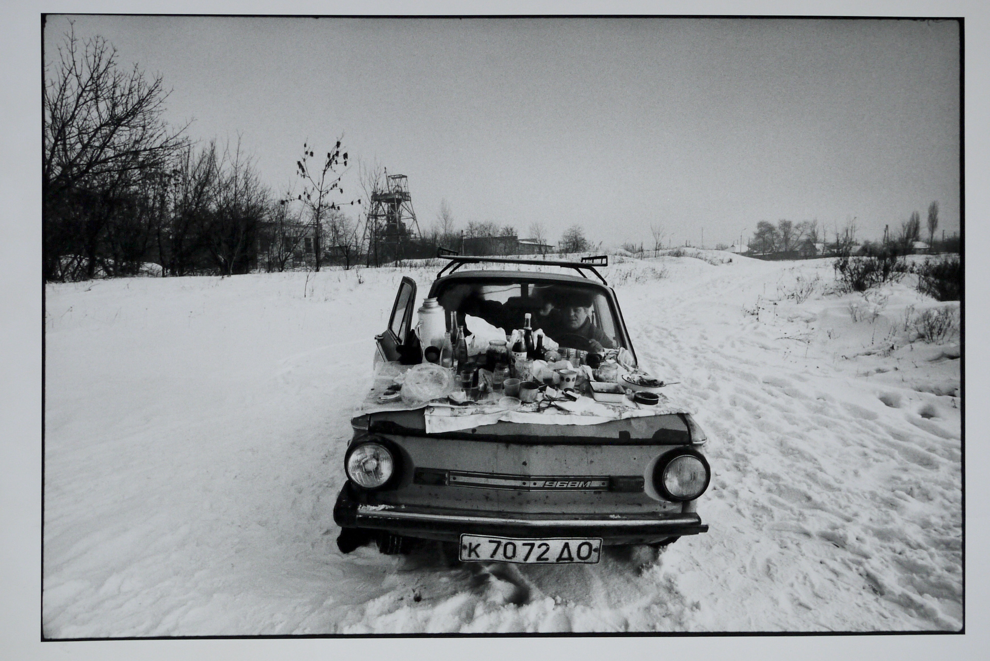 A family tries to keep warm in their car on New Year's Day, 1992. The temperature was -15C.