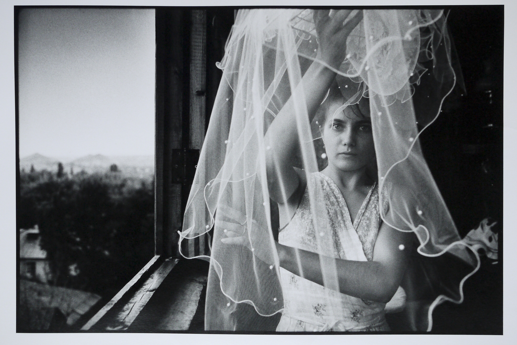 Irina Slakar preparing her veil on her wedding day. She is marrying Demitri, a former miner at the Socialist Donbass coal mine, Donetsk, June 1993.