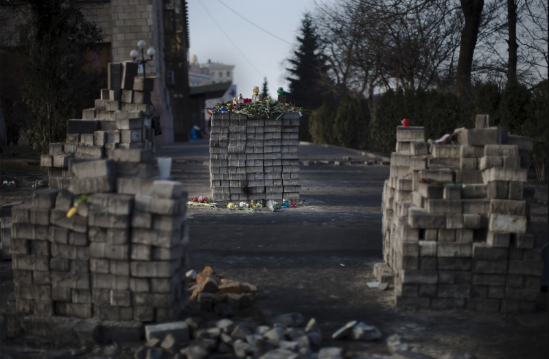 Piles of bricks to memorialise where protesters had been shot. Kiev, February 2014.