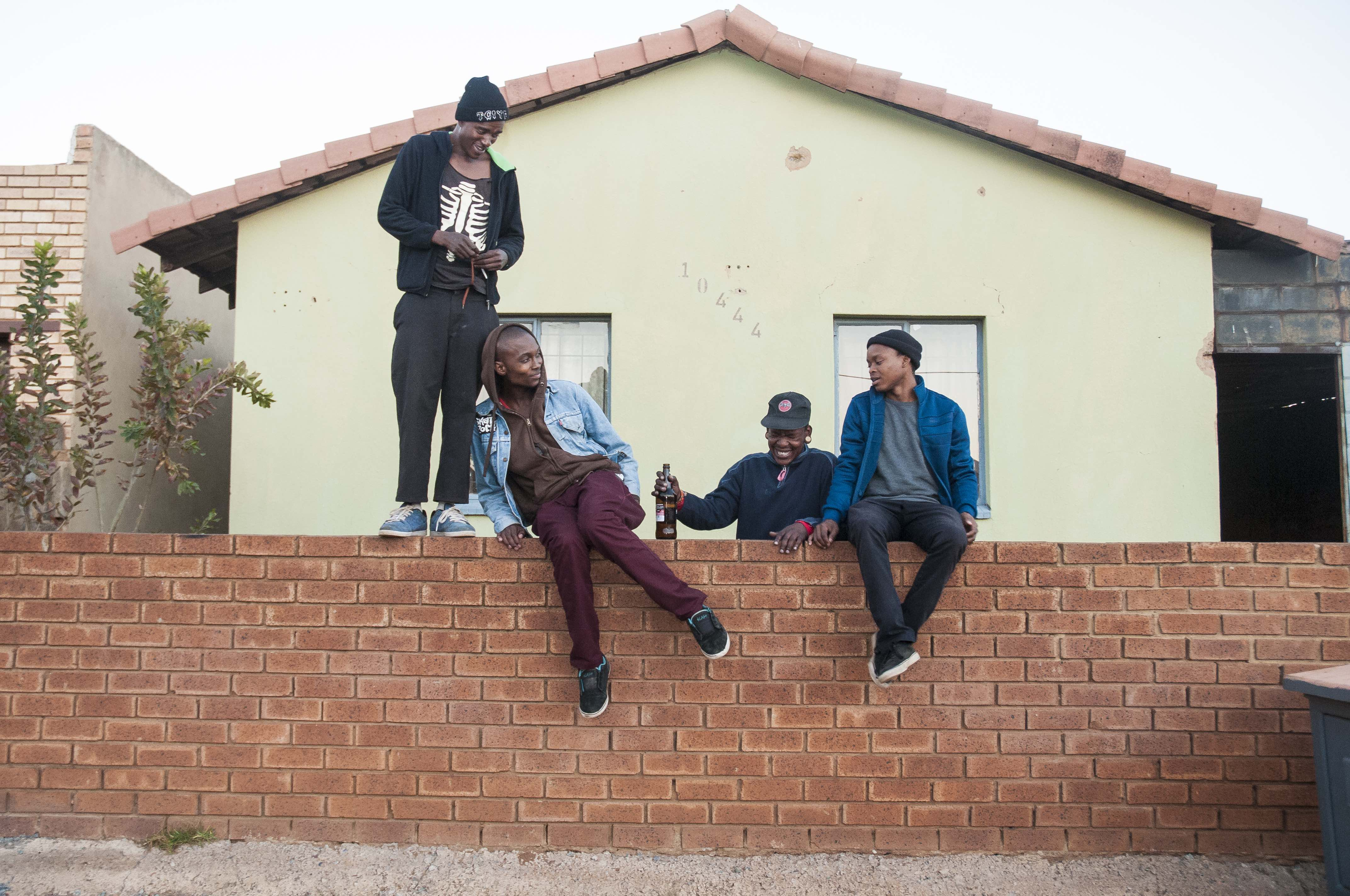 Hanging out at the Dogg Pound, TCIYF's skate house.  Left to right: Thula, guitarist; Pule, lead vocalist;  Jazz, drummer; Toxic, bassist.