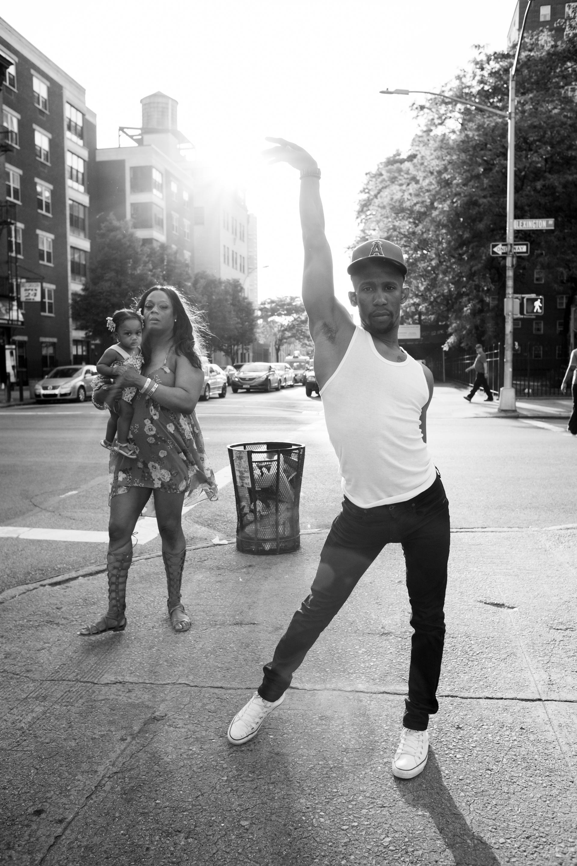 Derek Auguste strikes a vogue pose on Lexington Avenue in East Harlem, NY.