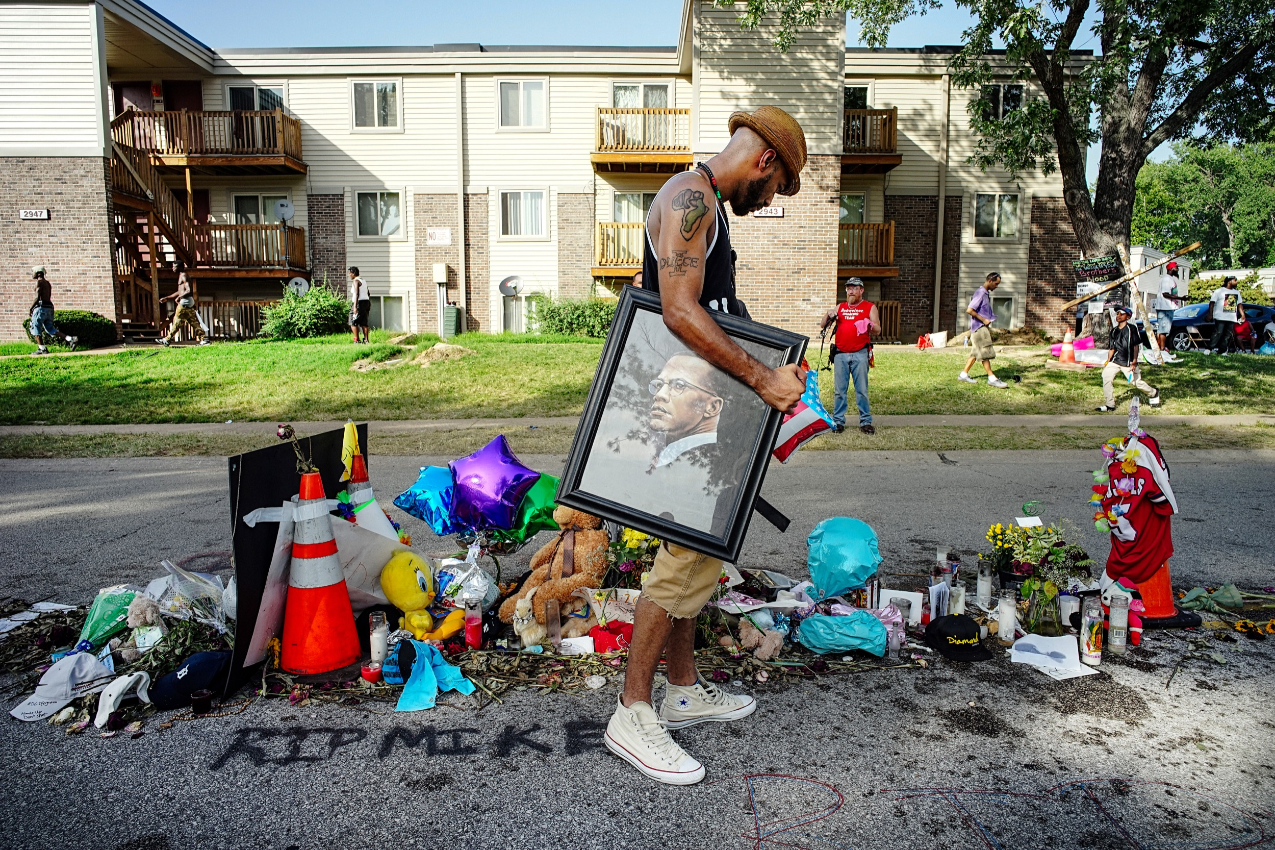 A makeshift shrine commemorating where Michael Brown was killed in Ferguson, Missouri.