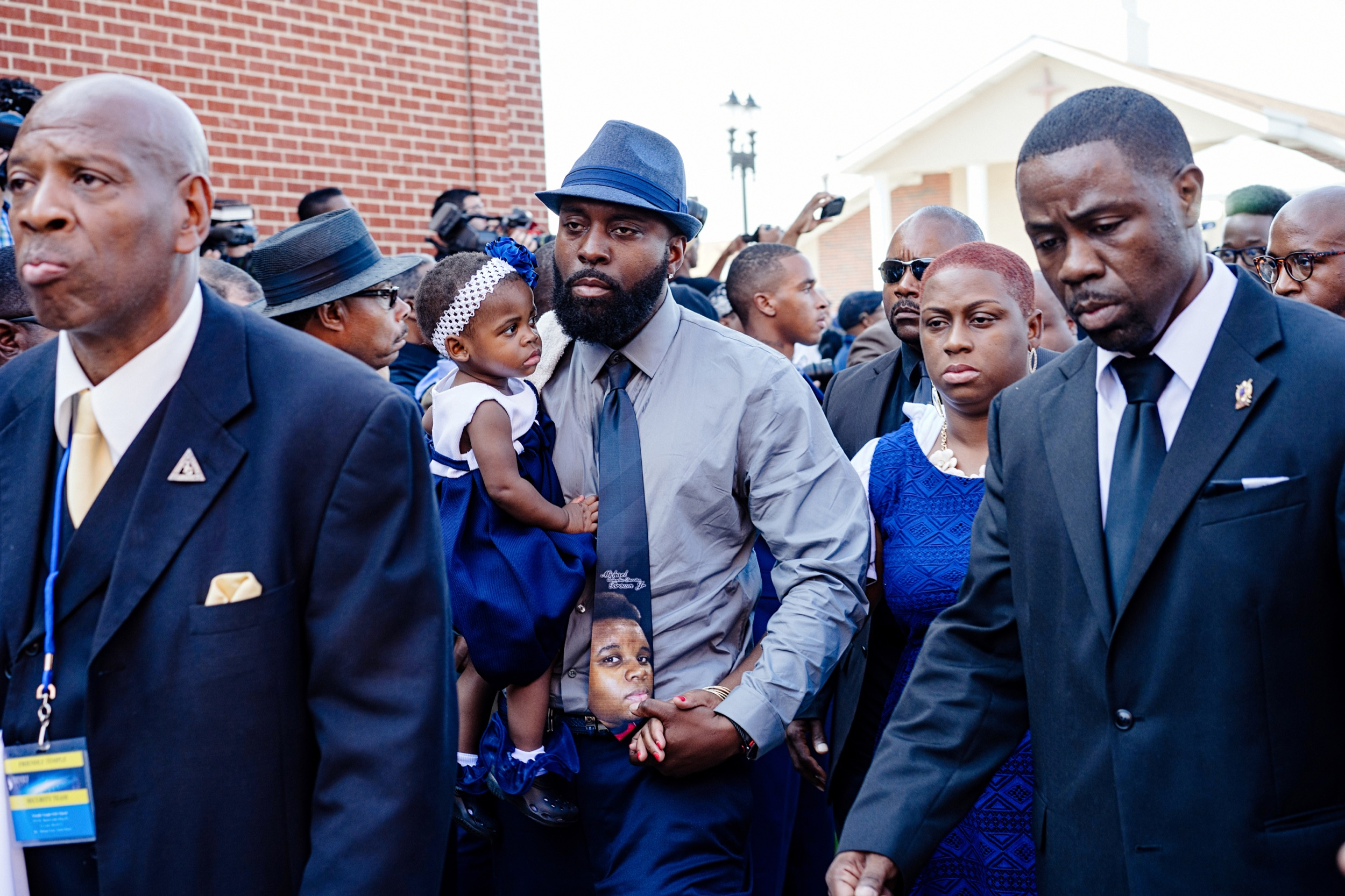 Michael Brown Sr. walks into the Friendly Temple Missionary Baptist Church, St. Louis, Missouri, to attend the funeral service of his son, Michael Brown Jr.