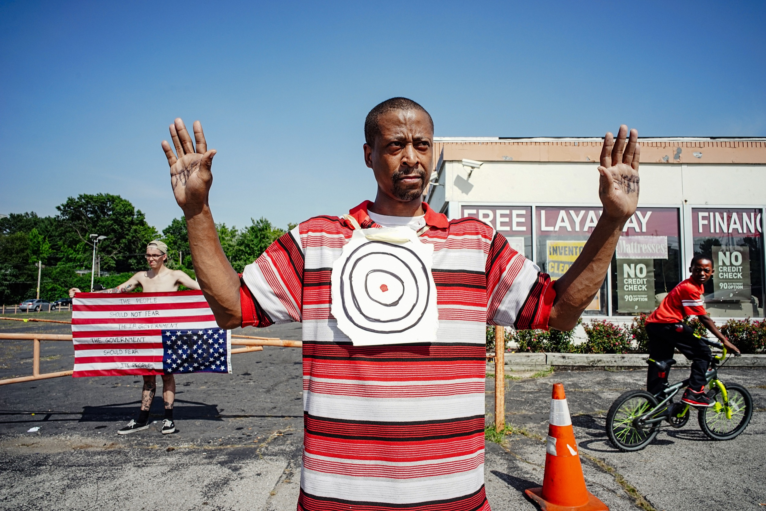 """Someone has to stand up to these crooked cops and now is the time,"" says Lawrence McNair while standing on Florissant Street in Ferguson, Missouri."