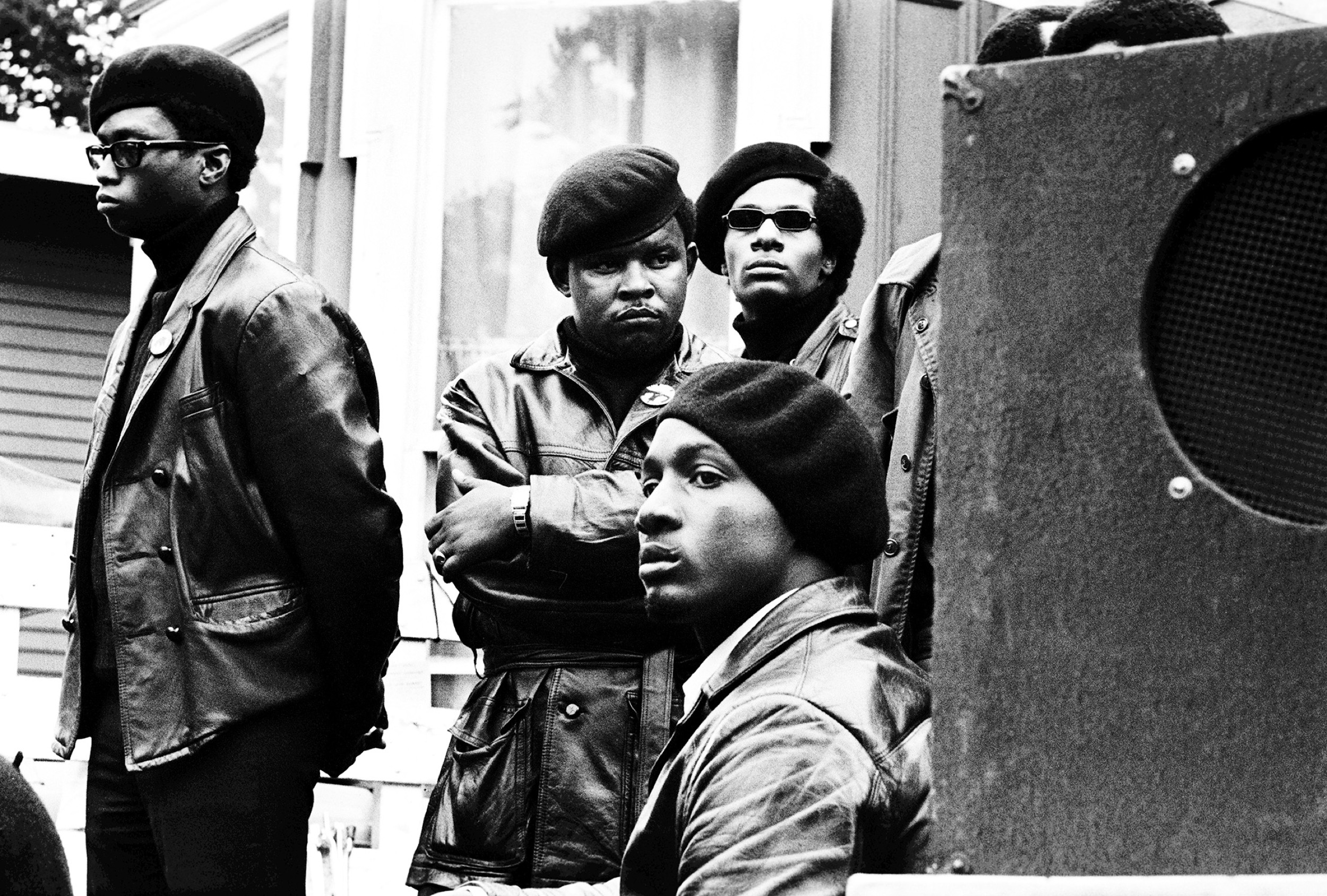 Panthers stand just offstage at a Free Huey rally in DeFremery Park, Oakland, 1968. Che Brooks (arms folded) was a San Francisco Panther who went to San Quentin State Prison and started the prison chapter.