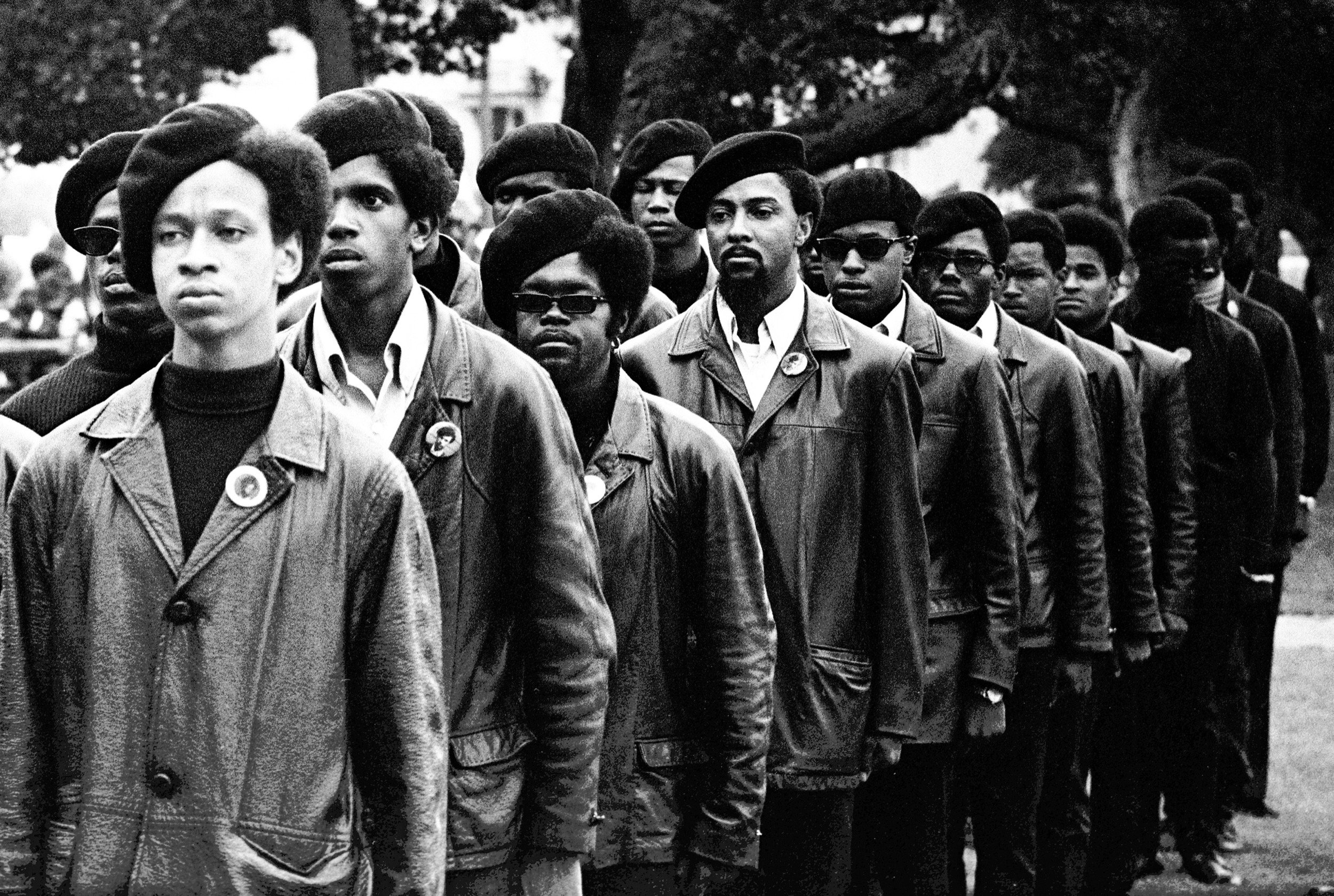 Panthers line up at a Free Huey rally in DeFremery Park, Oakland, July 28, 1968. The light-skinned man is Gregory Harrison. His brother, Oleander, was in the group that went to Sacramento.