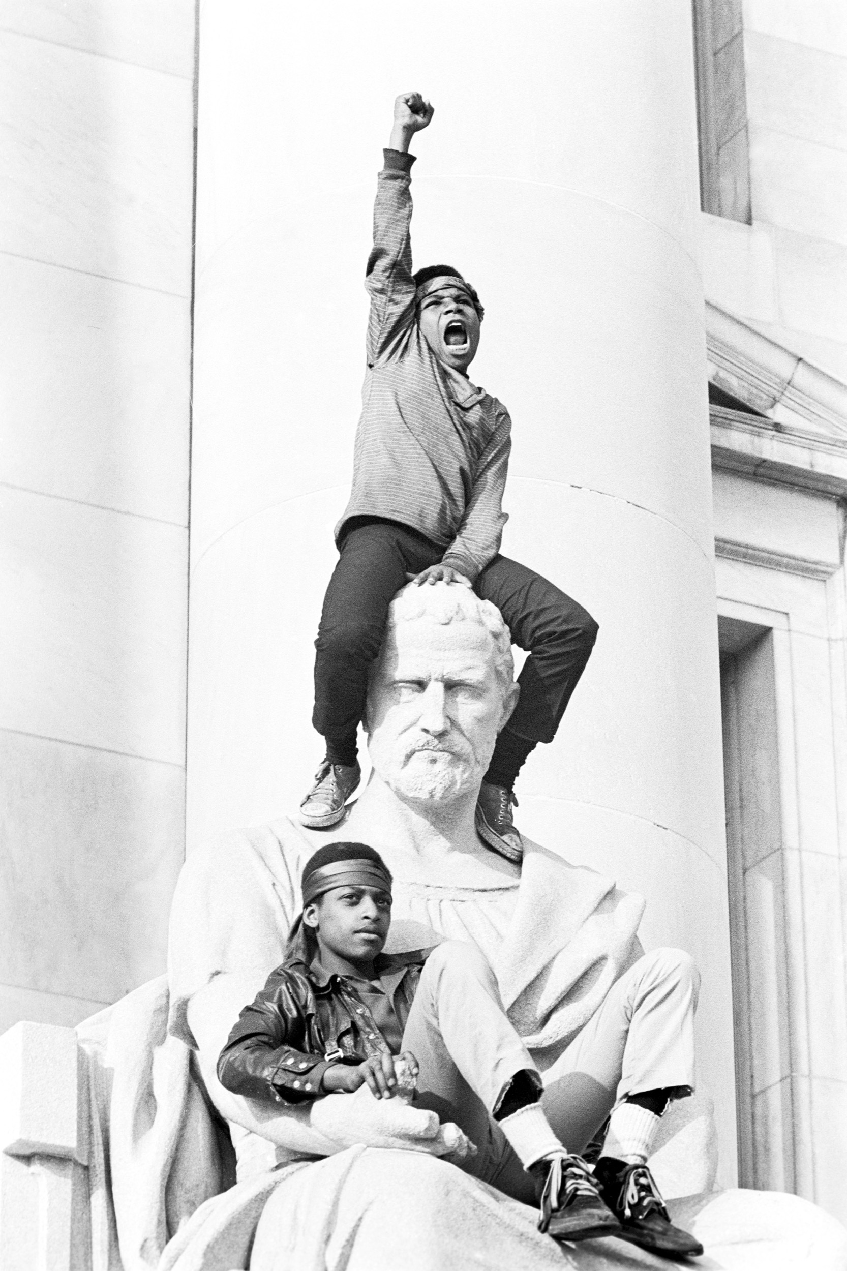 A boy salutes the Panthers, New Haven County Courthouse, May 1, 1970