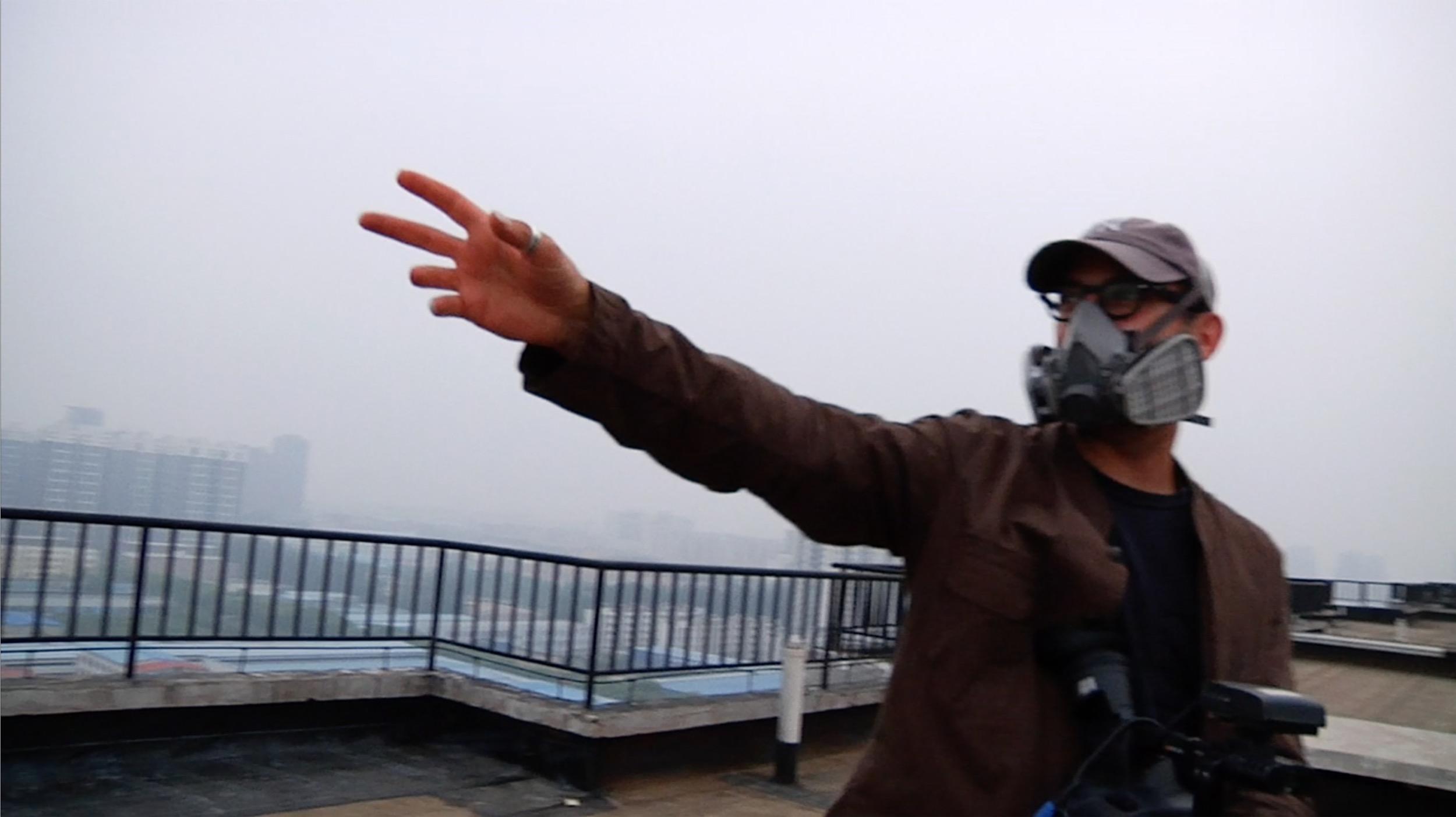 Josh Fox gestures to the oppressive smog from a rooftop in Beijing.
