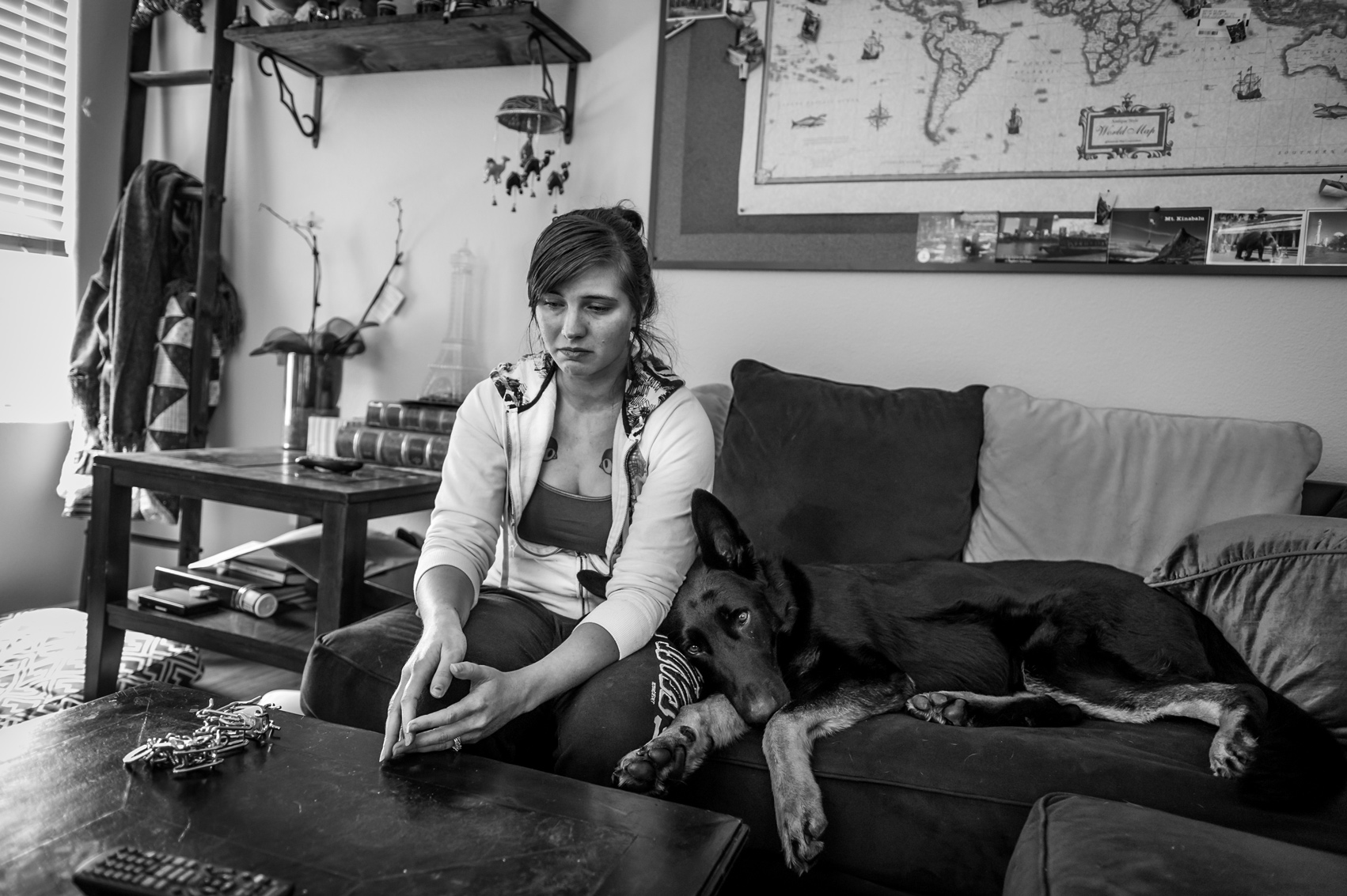 "Brittany Fintel was forced to leave the US Navy after she was pinned down on a bed by her lead petty officer while stationed in Bahrain. When she reported the incident she was told she had an 'adjustment disorder'. ""They kick the victim out. The victim is apparently more fucked in the head than the rapist,"" she says. Her PTSD service dog Indiana is never far from her side. Photo: Mary F. Calvert."