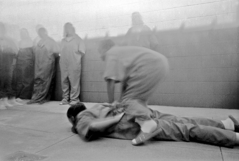 Incarcerated girls at Remann Hall, Tacoma, Washington, reenact restraint techniques in a pinhole camera workshop, 2002. Photo: Anonymous, courtesy of Steve Davis.