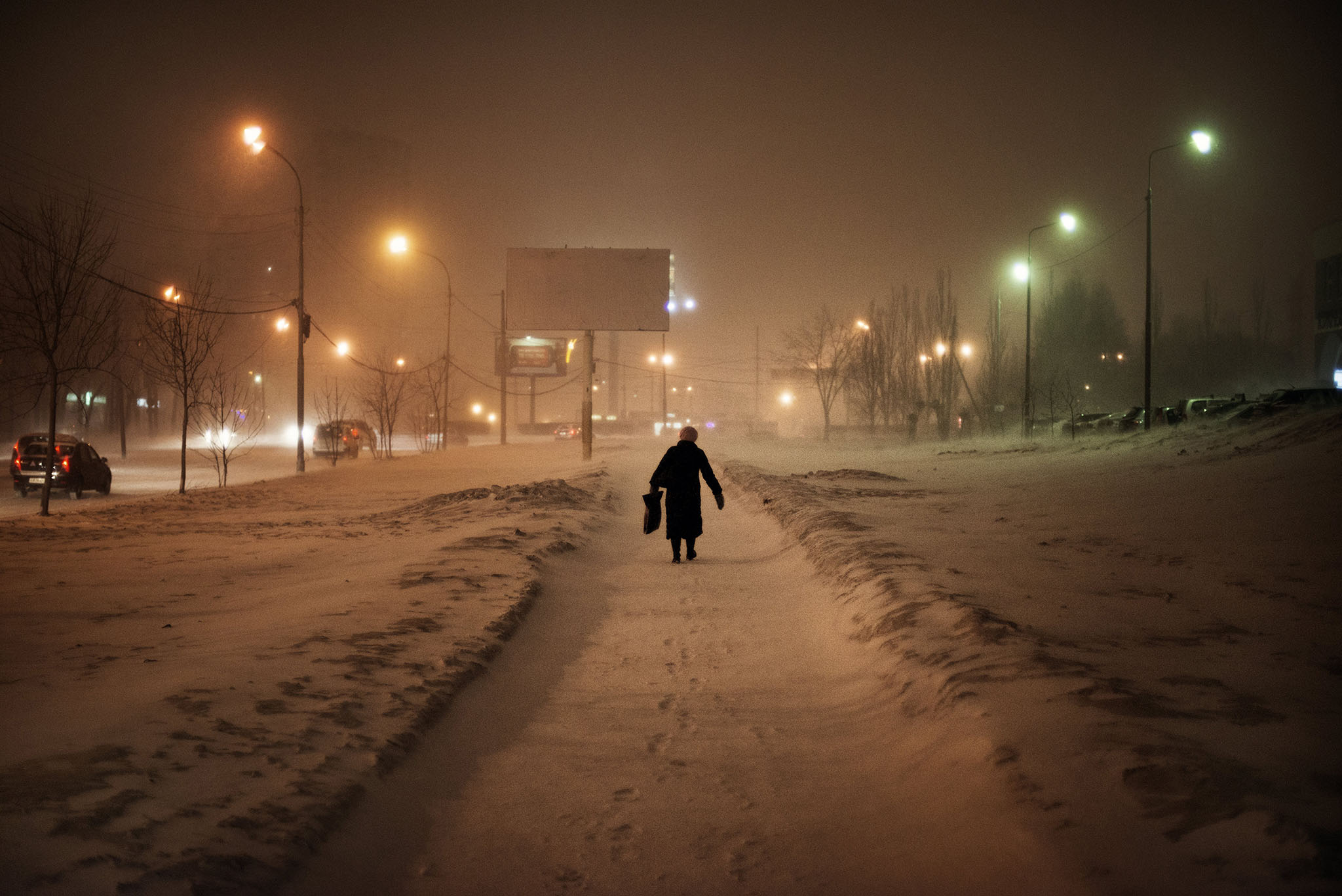 March 2013 - A woman walks on a street in the outskirts of Yekaterinburg.