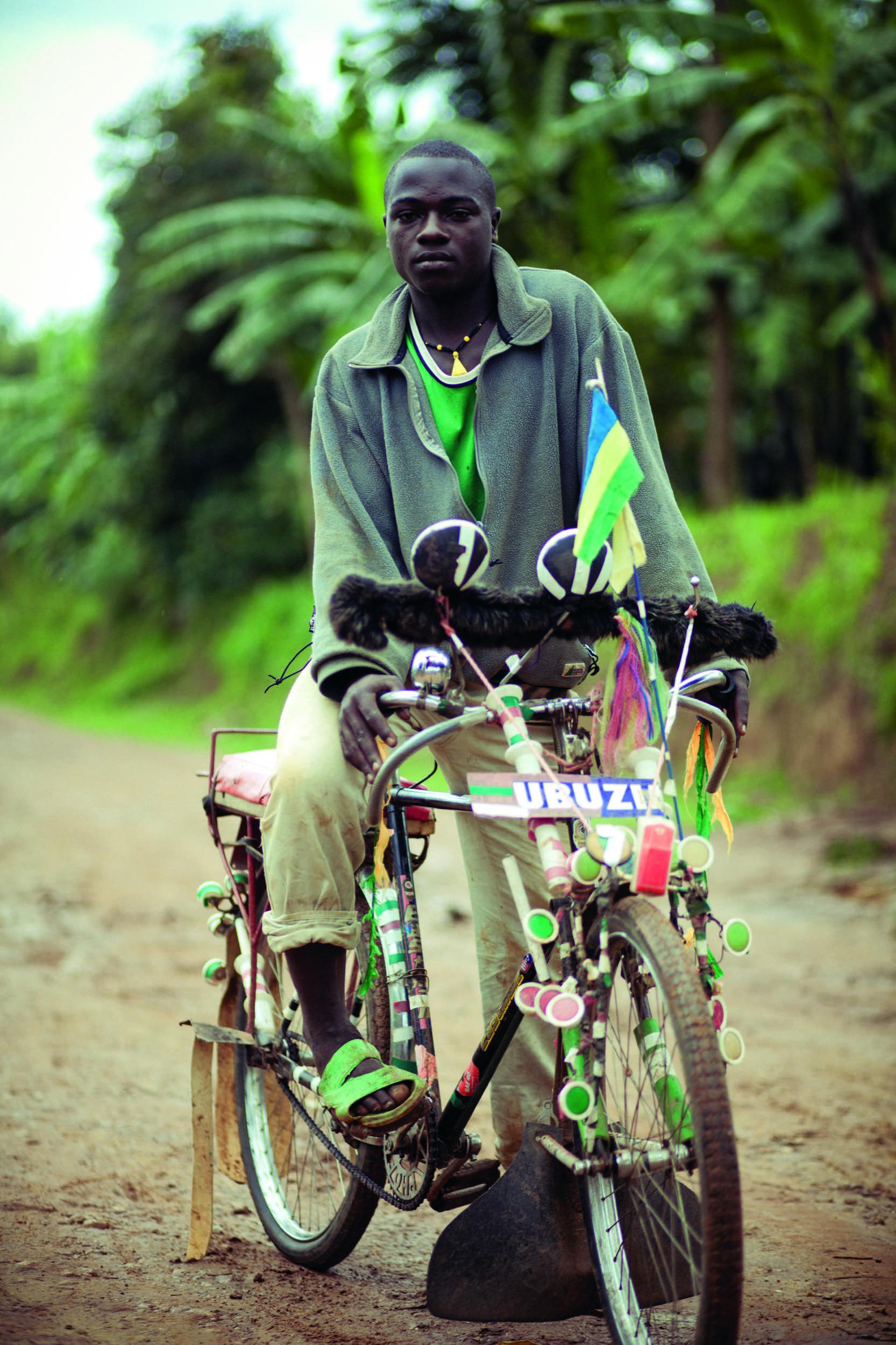 Minawi John, aged 19, on his customised pedicab. Nyamesheke District, Rwanda