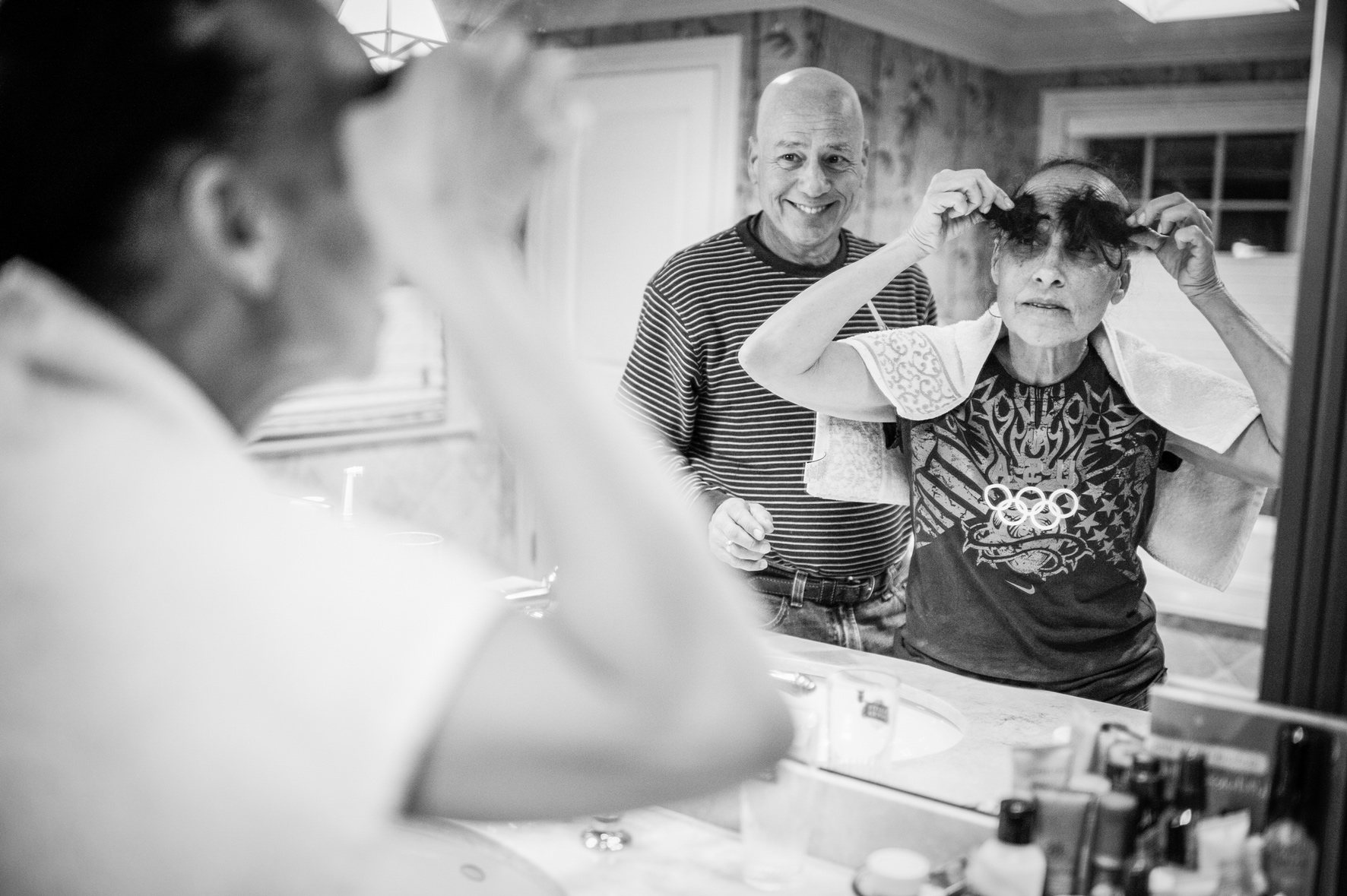 """Nancy Borowick's mother and father, having cut their hair knowing it would fall out as a side-effect of chemotherapy. """"Using humour allowed them to move forward and deal with what was happening because it was truly out of their control,"""" says Borowick. Photo: Nancy Borowick."""
