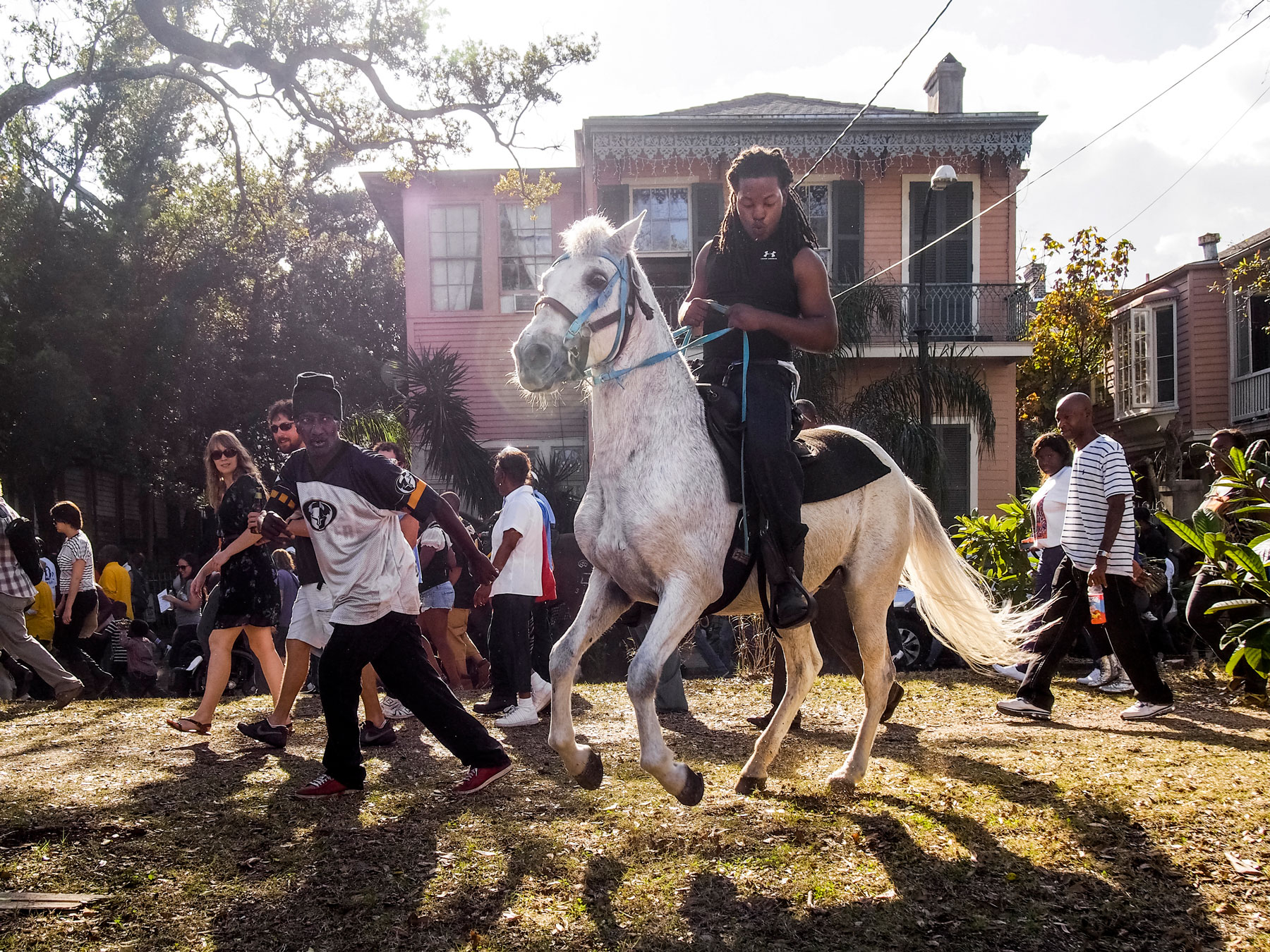 New Orleans, Louisiana. 2012. A Second Line parade: a local African American tradition where brass bands — known as the first line — march in the streets and are joined by members of the public — called the second liners.