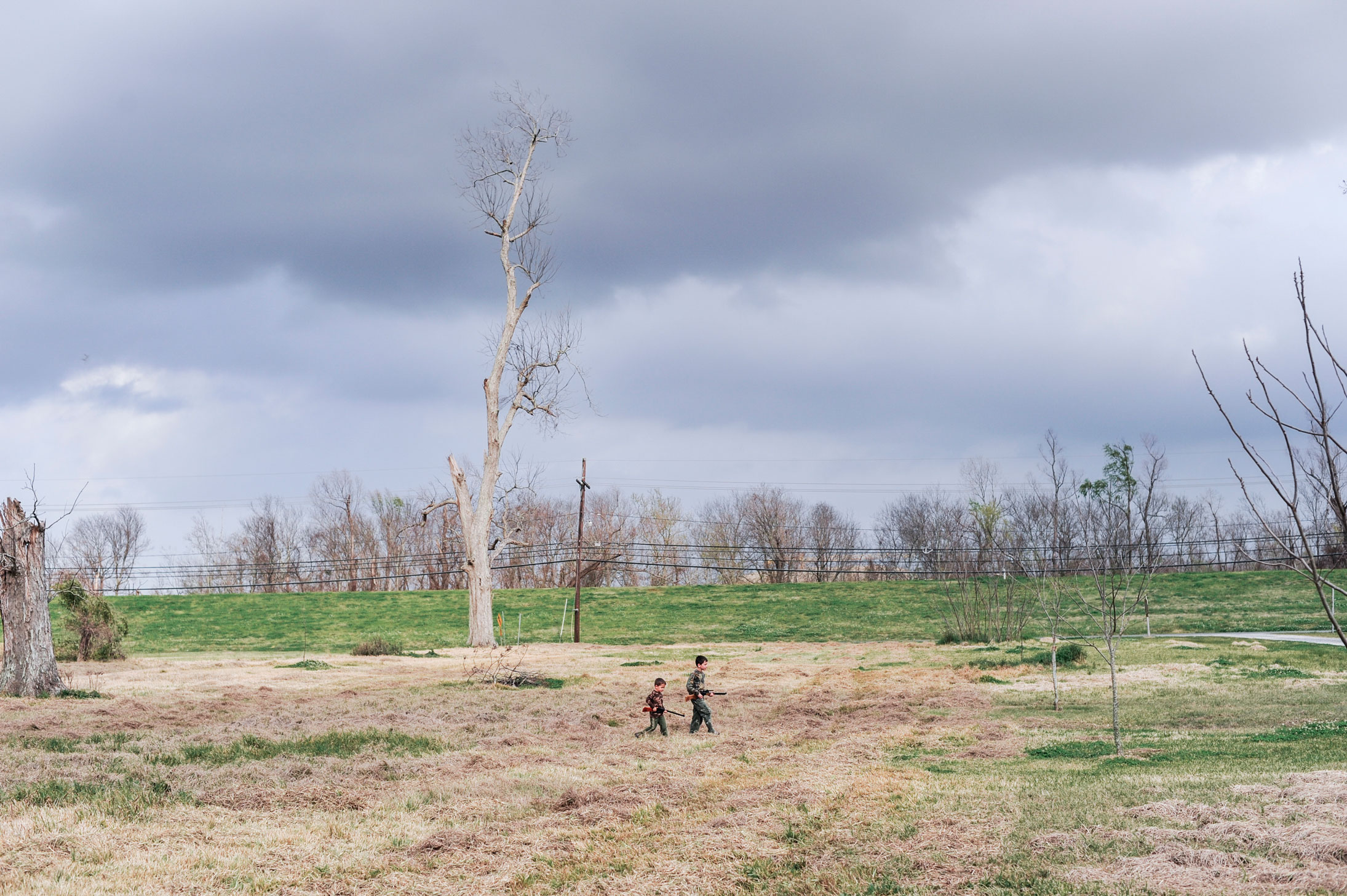 On the outskirts of New Orleans, Louisiana. 2009. Hunting rabbits with BB guns.