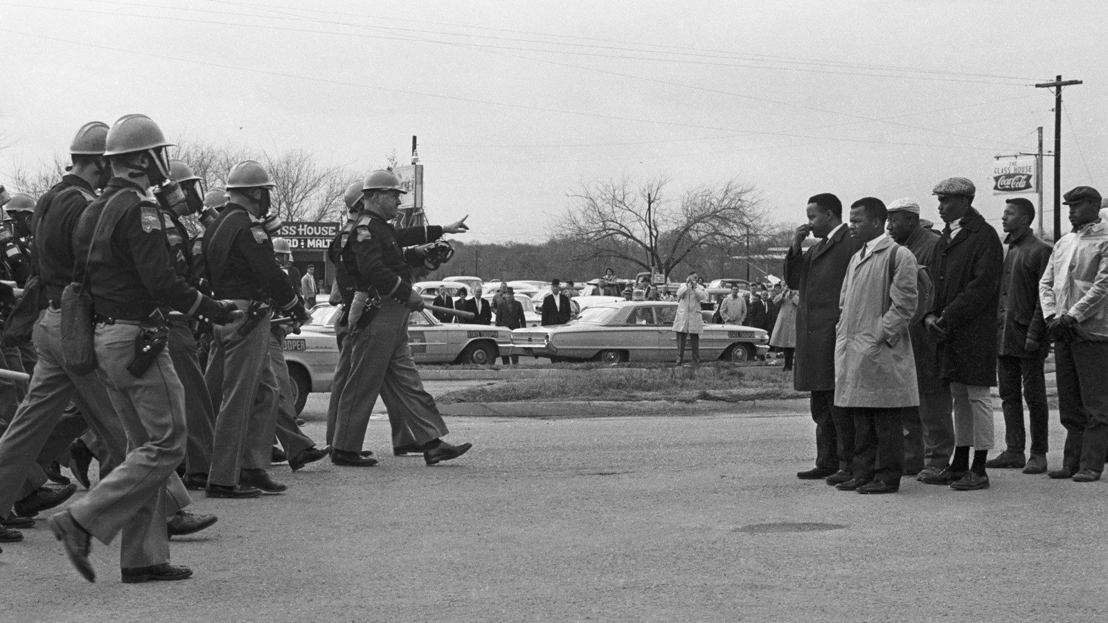 'Two Minute Warning.' Marchers face a line of state troopers in Selma, Alabama moments before police beat the protestors on 7 March, 1965. Photo by Spider Martin, courtesy of Magnolia Pictures.
