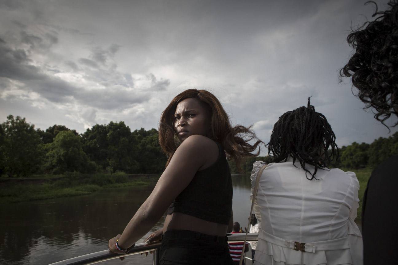 Singer Annet Angaika ('Neetha Baby') on a boat cruising across the White Nile River.