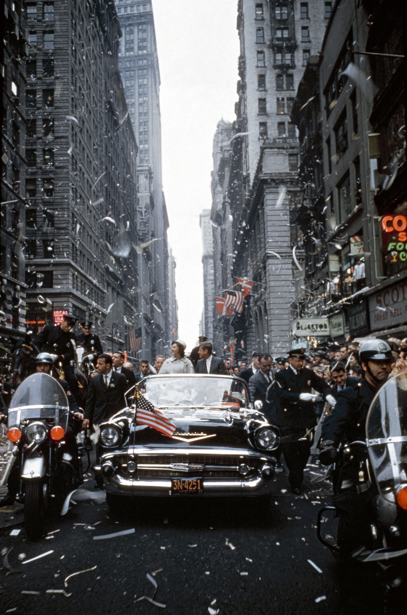 USA. New York City. 1960. Senator John F. KENNEDY and Jacqueline KENNEDY campaign during a ticker tape parade in Manhattan. Photo by Cornell Capa © International Center of Photography.