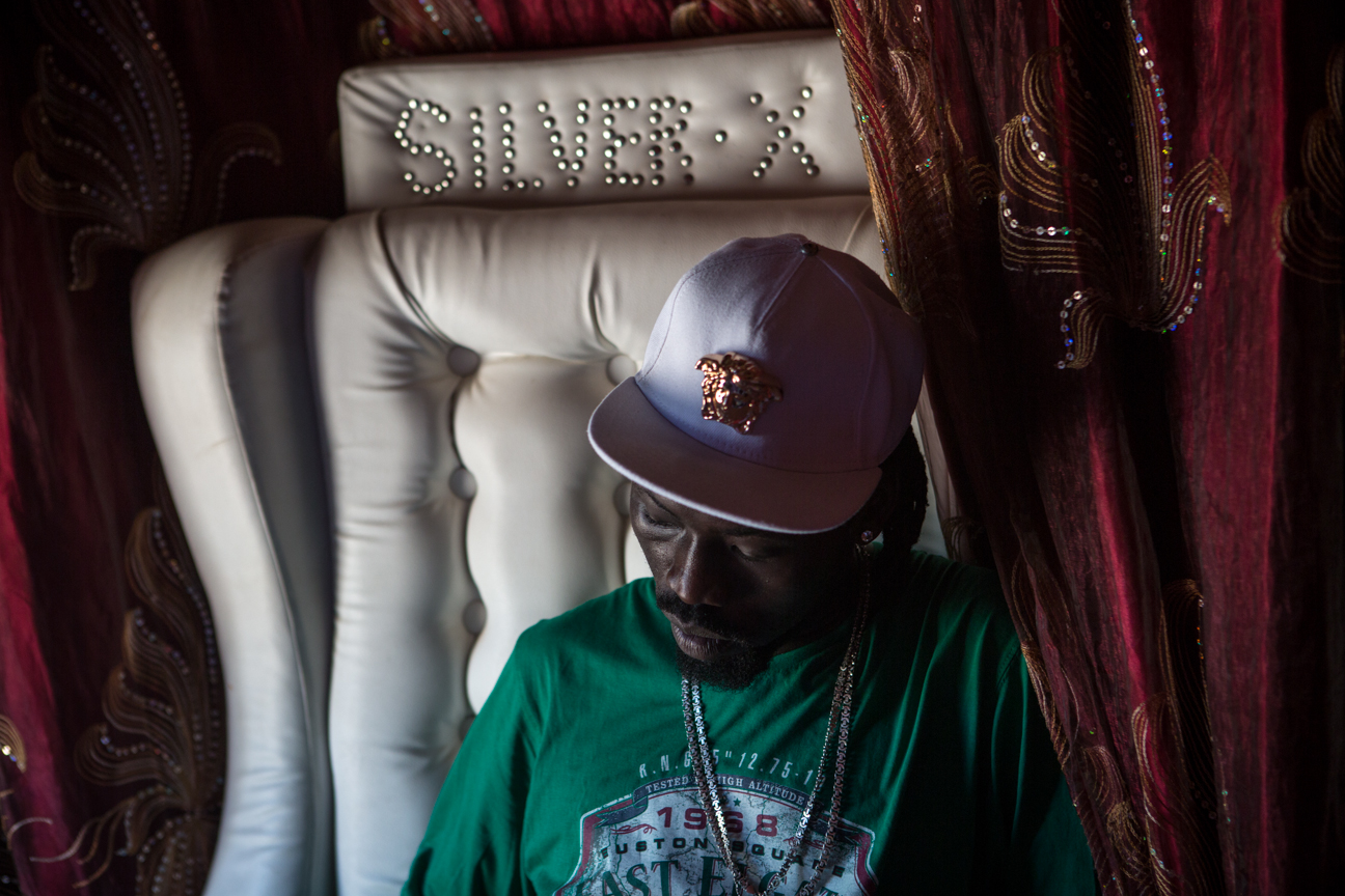 Singer Okuta Ceasar Malis, known as 'Silver X', in his custom-made armchair and imported convertible in Juba.
